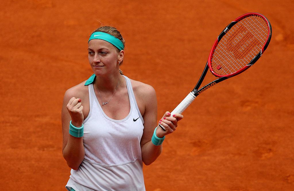 Petra Kvitova of the Czech Republic celebrates match point against Serena Williams of the United States in their semi final match during day seven of the Mutua Madrid Open tennis tournament at the Caja Magica on May 8, 2015 in Madrid, Spain. (Photo by Clive Brunskill/Getty Images)