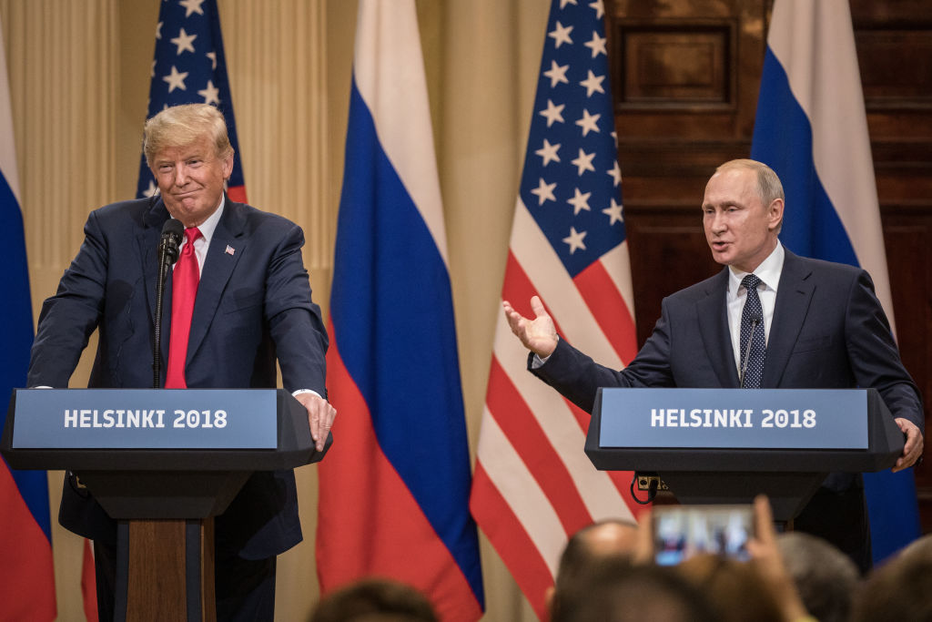 U.S. President Donald Trump and Russian President Vladimir Putin answers questions about the 2016 U.S. Election collusion during a joint press conference after their summit on July 16, 2018, in Helsinki, Finland (Source: Chris McGrath/Getty Images)