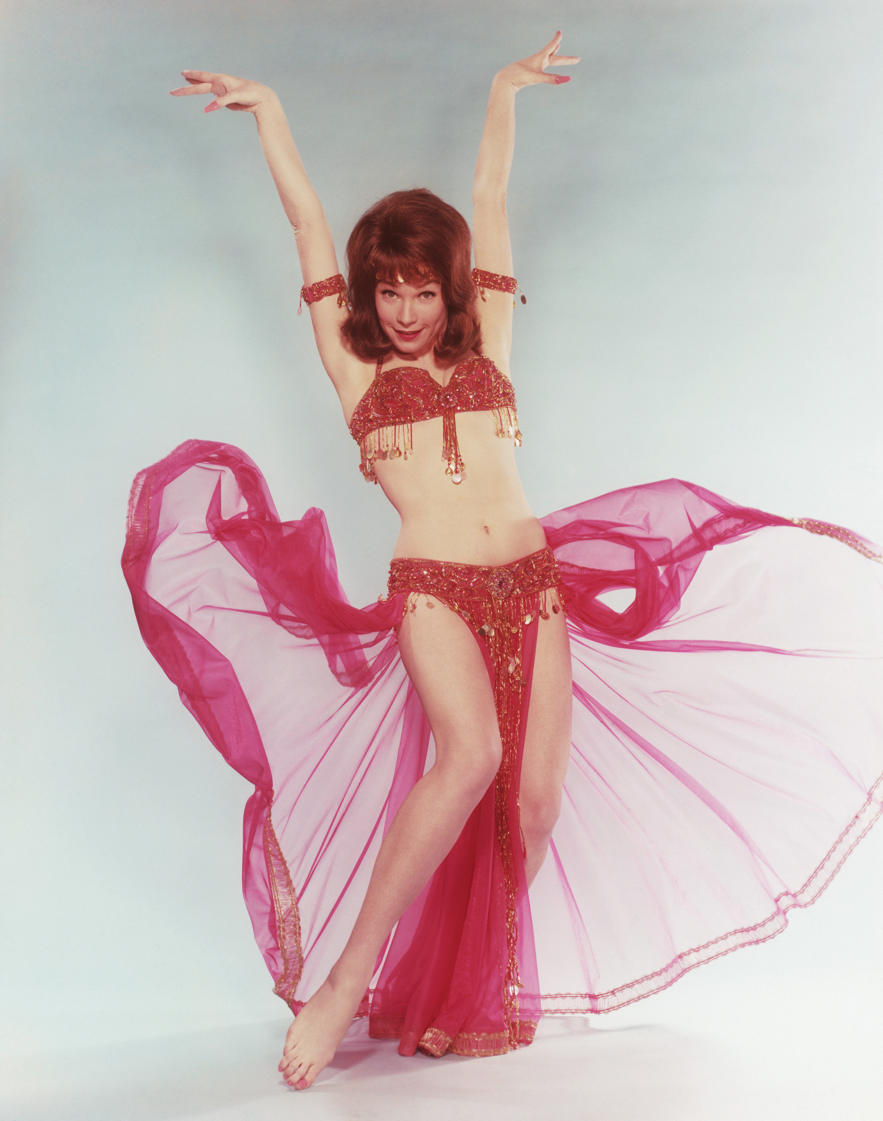 American actress Shirley Maclaine in a belly-dancing outfit in a publicity still for 'John Goldfarb, Please Come Home', directed by J. Lee Thompson, 1965. (Photo by Keystone/Hulton Archive/Getty Images)