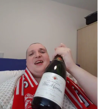 Crawford posted a picture of himself with a bottle of champagne while still at the hospital (Source: YouTube)