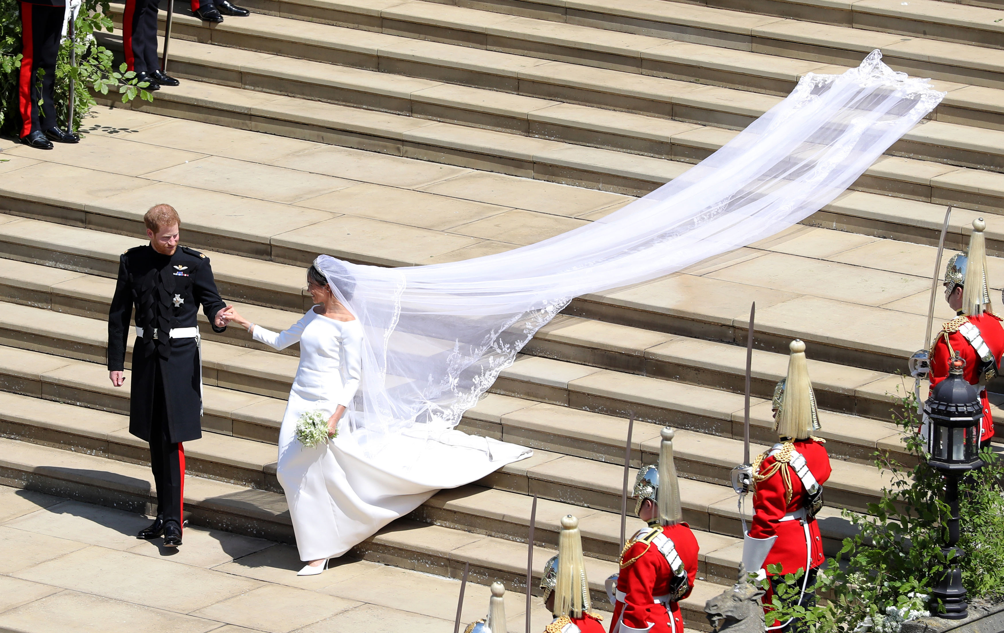 Prince Harry, Duke of Sussex and The Duchess of Sussex leave St George's Chapel, Windsor Castle after their wedding ceremony on May 19, 2018, in Windsor, England. (Getty Images)