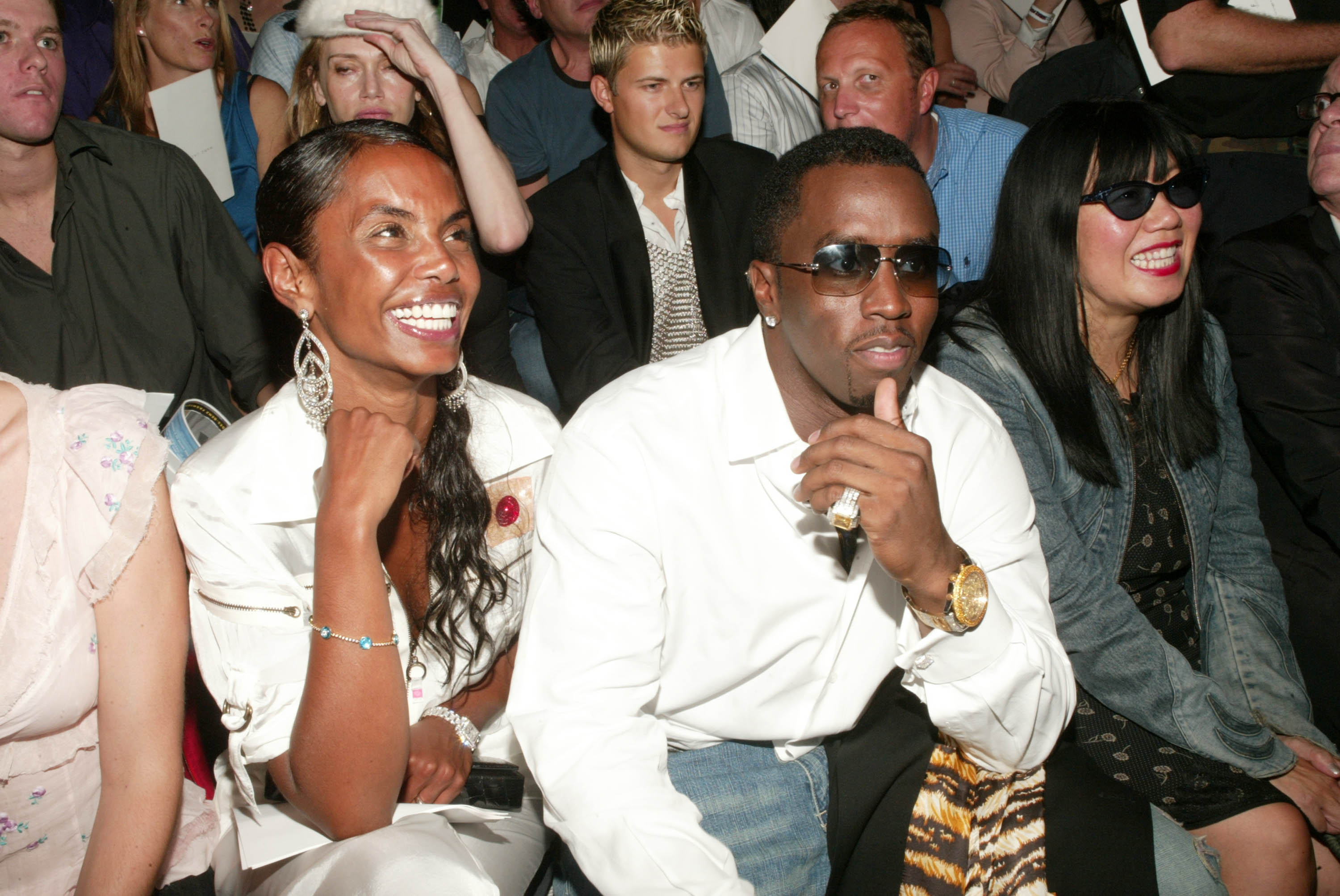 Sean 'P. Diddy' Combs and girlfriend Kim Porter attend the Marc Jacobs Spring/Summer 2004 Collection at the Manhattan Armory during the 7th on Sixth Mercedes-Benz Fashion Week on September 15, 2003, in New York City. (Getty Images)