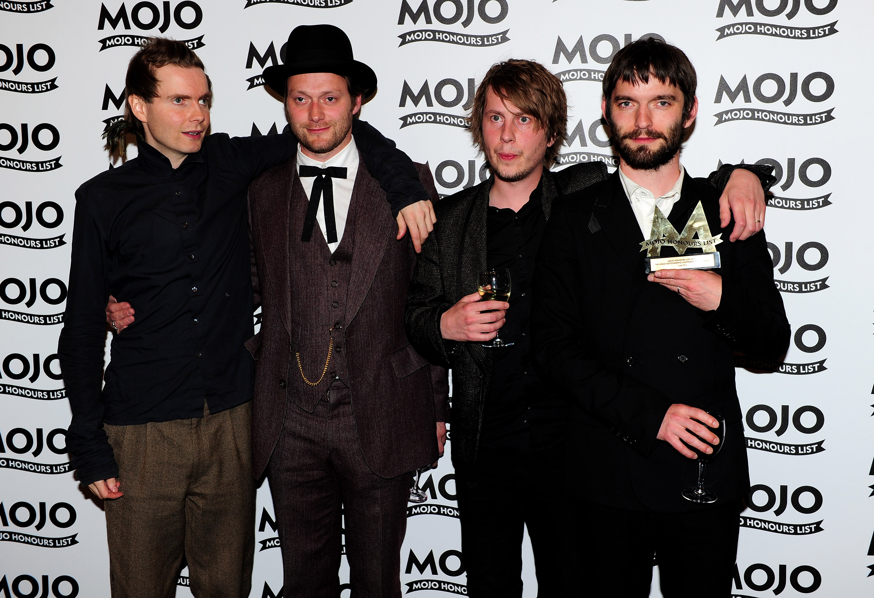 Sigur Ros pose with the MOJO Outstanding Contribution to Music Award. (Photo by Gareth Cattermole/Getty Images)
