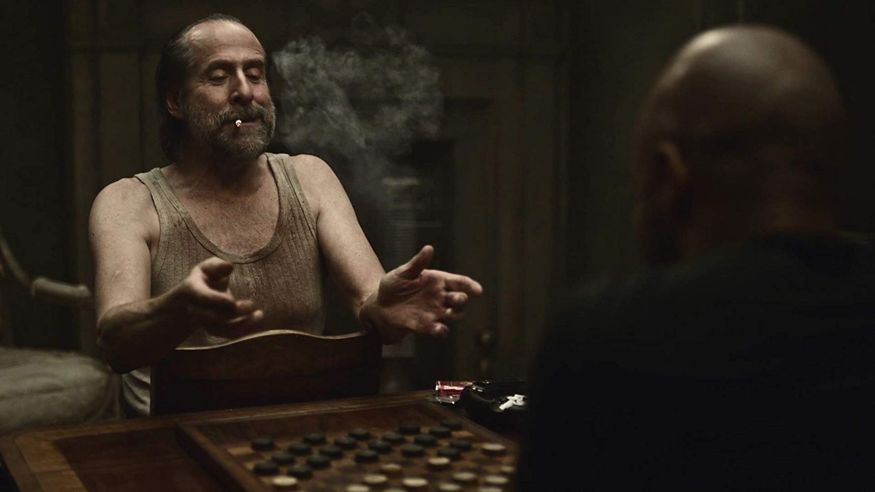 Czernobog playing a game of checkers with Shadow on 'American Gods'. Source: IMDB