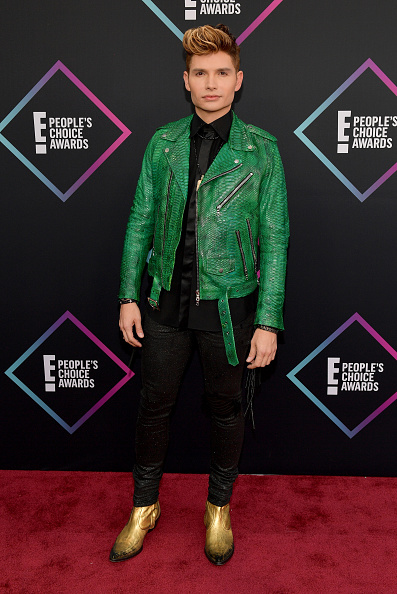 Unconventional? Sure. Christian Acosta put his best fashion foot forward in a black ensemble and gold shoes. Adding a pop of color with this green leather piece was definitely a great idea! (Photo by Matt Winkelmeyer/Getty Images)