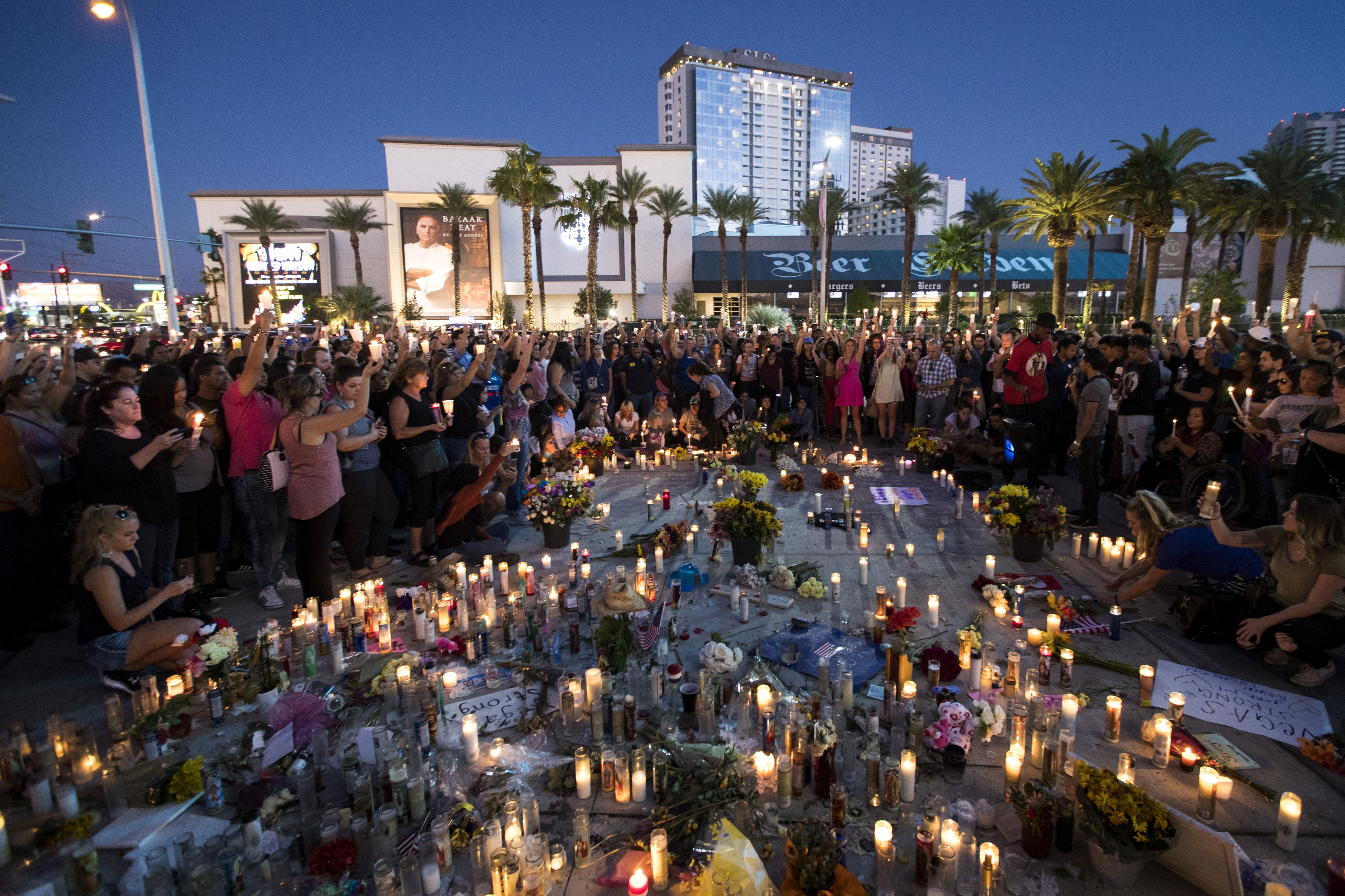 Mourners hold their candles in the air during a moment of silence during a vigil to mark one week since the mass shooting at the Route 91 Harvest country music festival, on the corner of Sahara Avenue and Las Vegas Boulevard at the north end of the Las Vegas Strip, on October 8, 2017, in Las Vegas, Nevada. On October 1, Stephen Paddock killed 58 people and injured more than 450 after he opened fire on a large crowd at the Route 91 Harvest country music festival. The massacre is one of the deadliest mass shooting events in U.S. history. (Source: Drew Angerer/Getty Images)