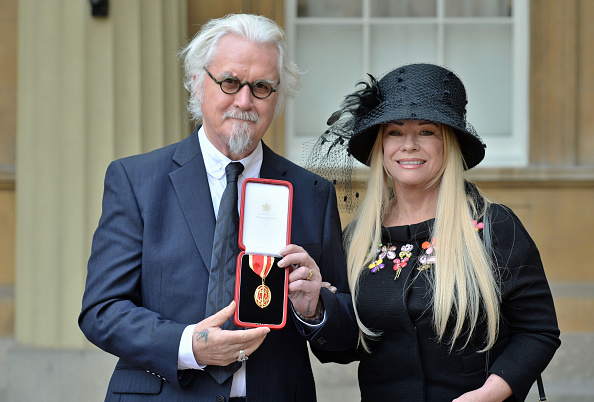 Sir Billy Connolly poses with his wife Pamela Stephenson, after being knighted by the Duke of Cambridge. (Getty Images)