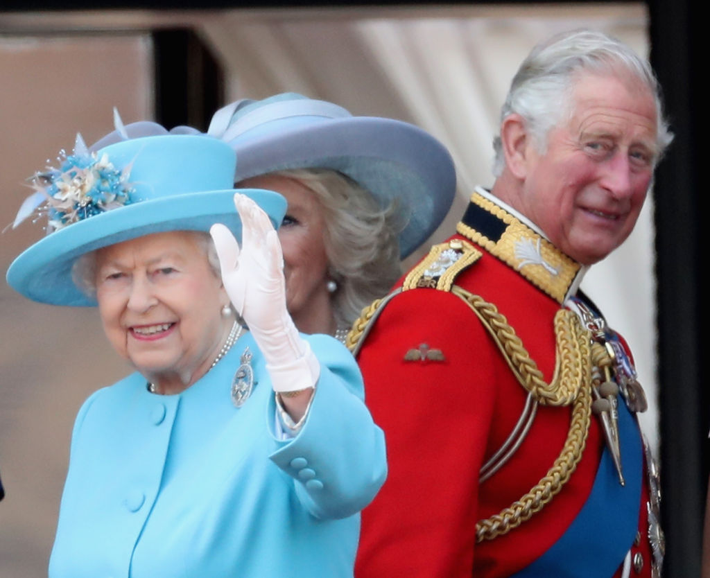 Queen Elizabeth II and Prince Charles, Prince of Wales watch the flypast on the balcony of Buckingham Palace during Trooping The Colour on June 9, 2018 in London, England (Photo by Chris Jackson/Getty Images)