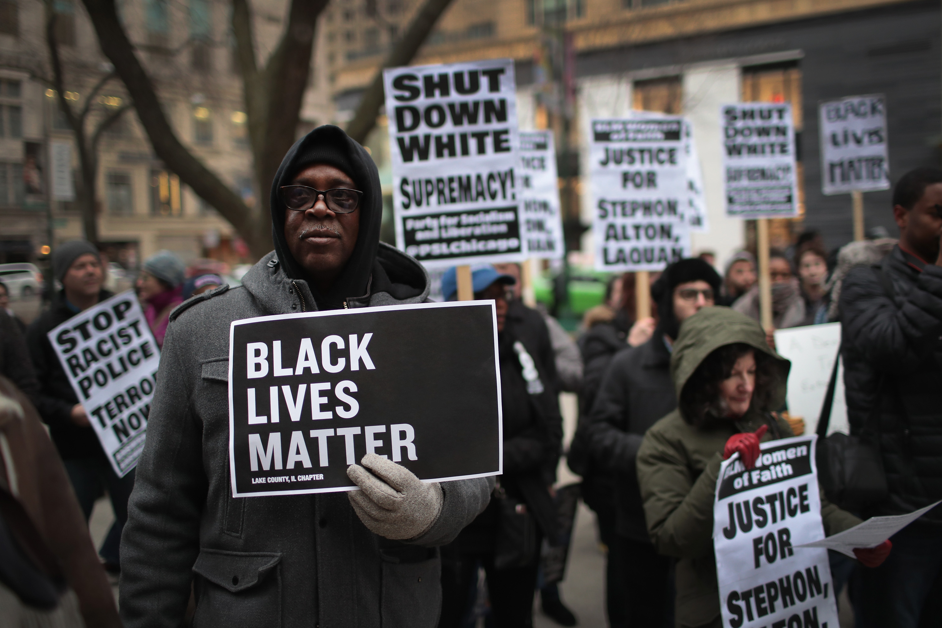 In recognition of the 50th anniversary of the death of Dr. Martin Luther King Jr., and in solidarity with the family and supporters of Stephon Clark and others killed by police, demonstrators protest and march in the Magnificent Mile shopping district on April 2, 2018, in Chicago, Illinois. (Getty)