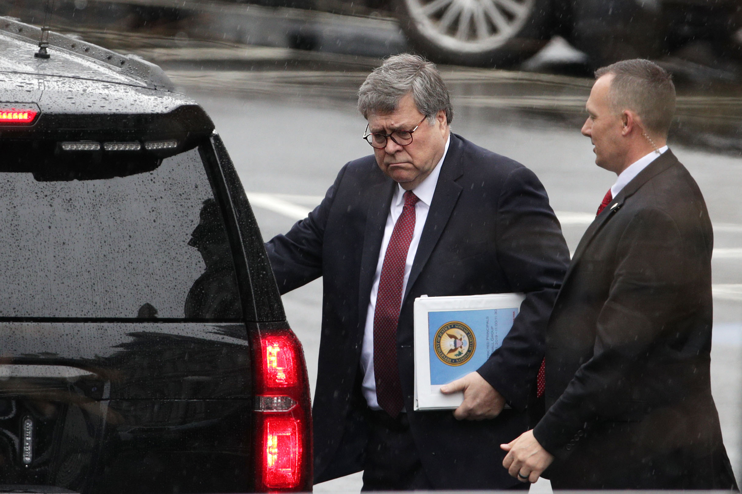 U.S. Attorney General William Barr (L) leaves after a meeting at the West Wing of the White House March 21, 2019, in Washington, DC. Key law-enforcement officials in Washington are preparing for the release of the report by special counsel Robert Mueller. (Getty Images)
