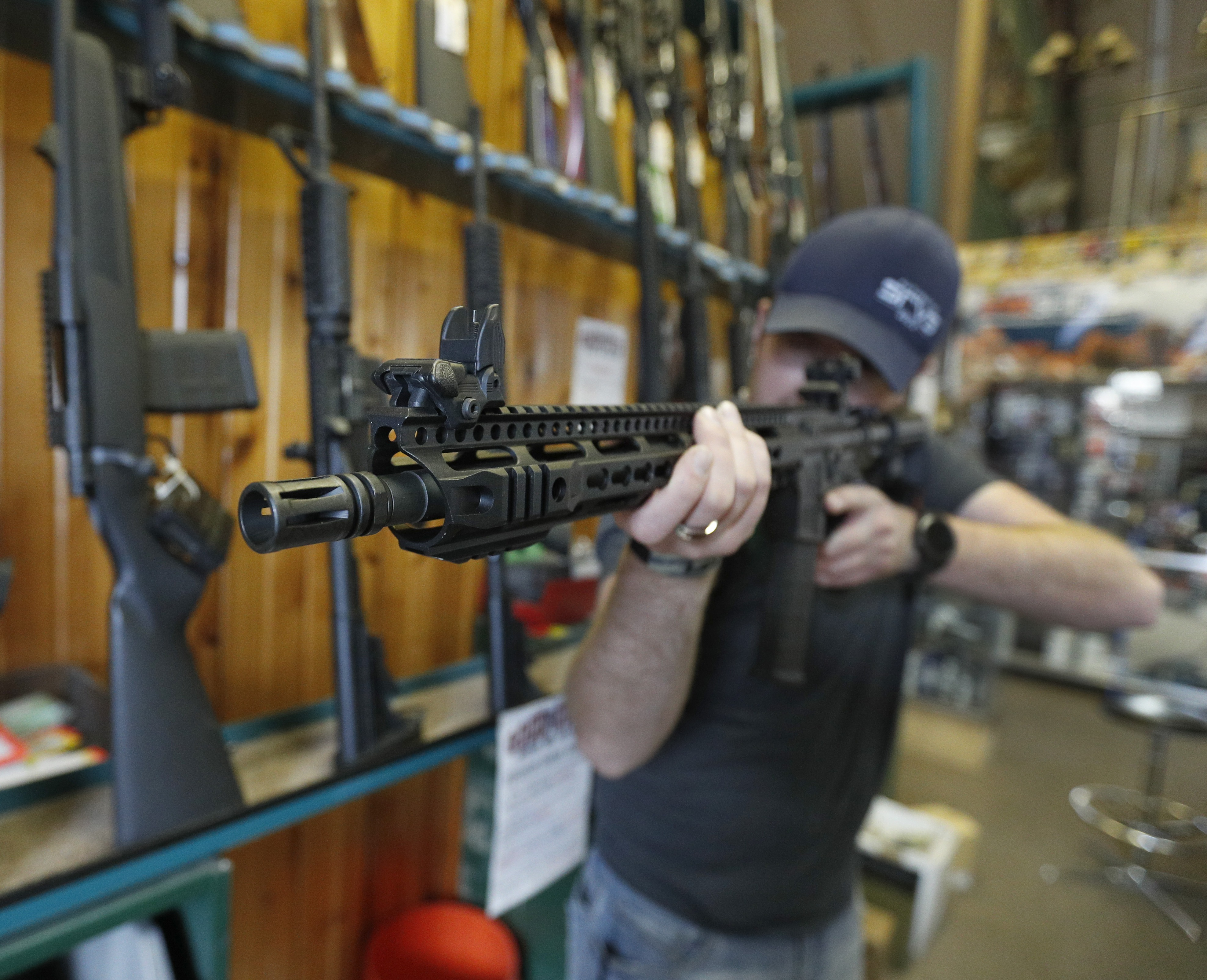 Dordon Brack aims a semi-automatic AR-15 that is for sale at Good Guys Guns & Range on February 15, 2018, in Orem, Utah. (Getty)