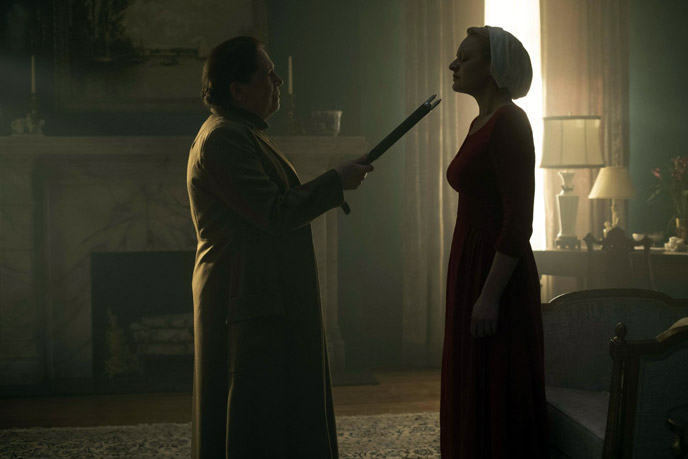 A still from The Handmaid's Tale featuring Elizabeth Moss as Offred and Ann Dowd as Aunt Lydia. (Source: Hulu)