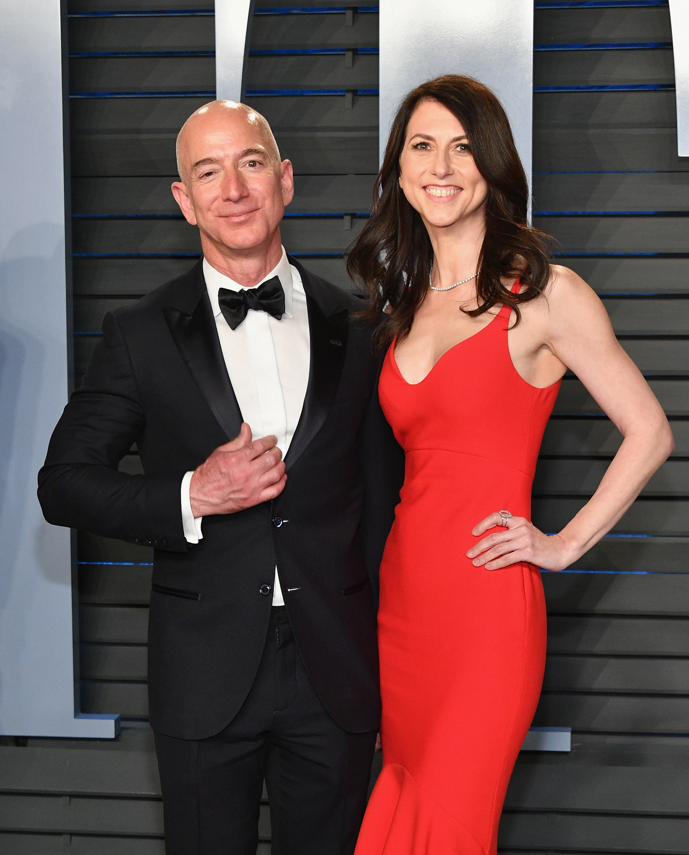 Jeff Bezos (L) and MacKenzie Bezos attend the 2018 Vanity Fair Oscar Party hosted by Radhika Jones at Wallis Annenberg Center for the Performing Arts on March 4, 2018, in Beverly Hills, California. (Getty)