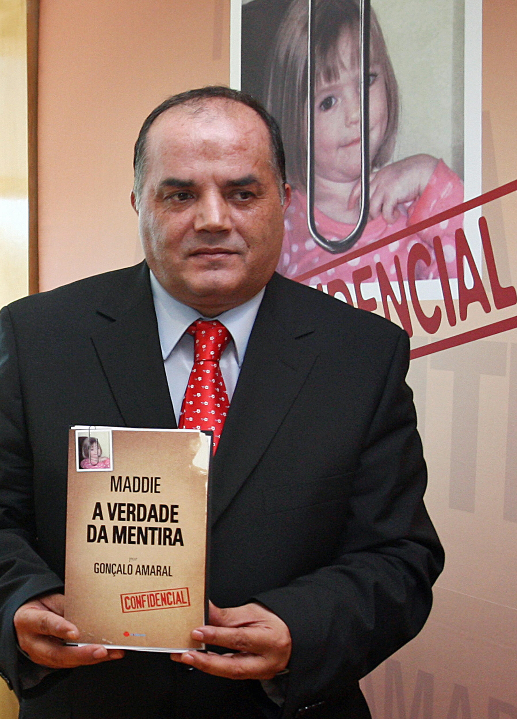"Former Policia Judiciaria (Crime Police) detective Goncalo Amaral holds a copy of his book entitled ""Maddie: The Truth about the Lie"" (Source: Joao Cortesao/AFP/Getty Images)"