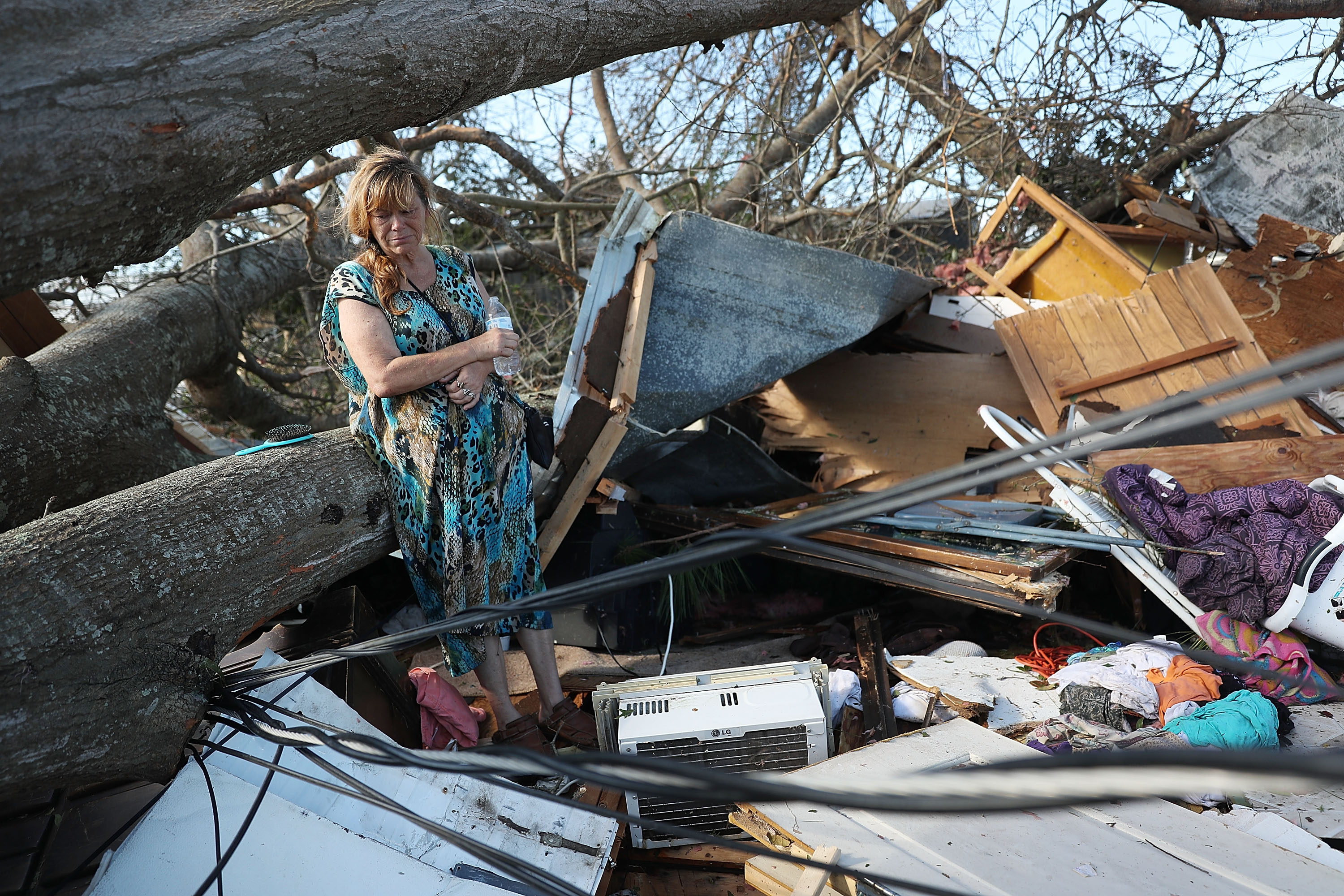 Kathy Coy stands among what is left of her home after Hurricane Michael destroyed it on October 11, 2018, in Panama City, Florida. She said she was in the home when it was blown apart and is thankful to be alive. The hurricane hit the Florida Panhandle as a category 4 storm. (Getty)