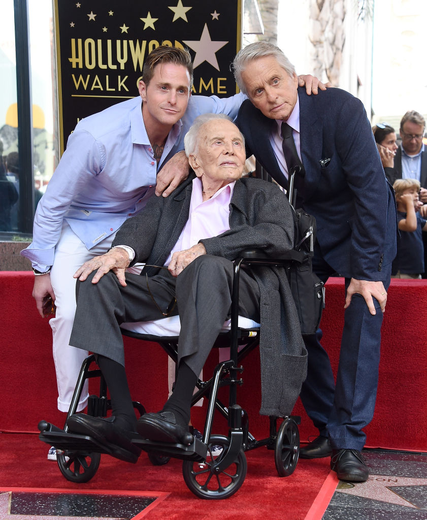 Cameron Douglas, Kirk Douglas, and Michael Douglas pose at the Michael Douglas Star On The Hollywood Walk Of Fame ceremony on November 6, 2018, in Hollywood, California. (Getty Images)