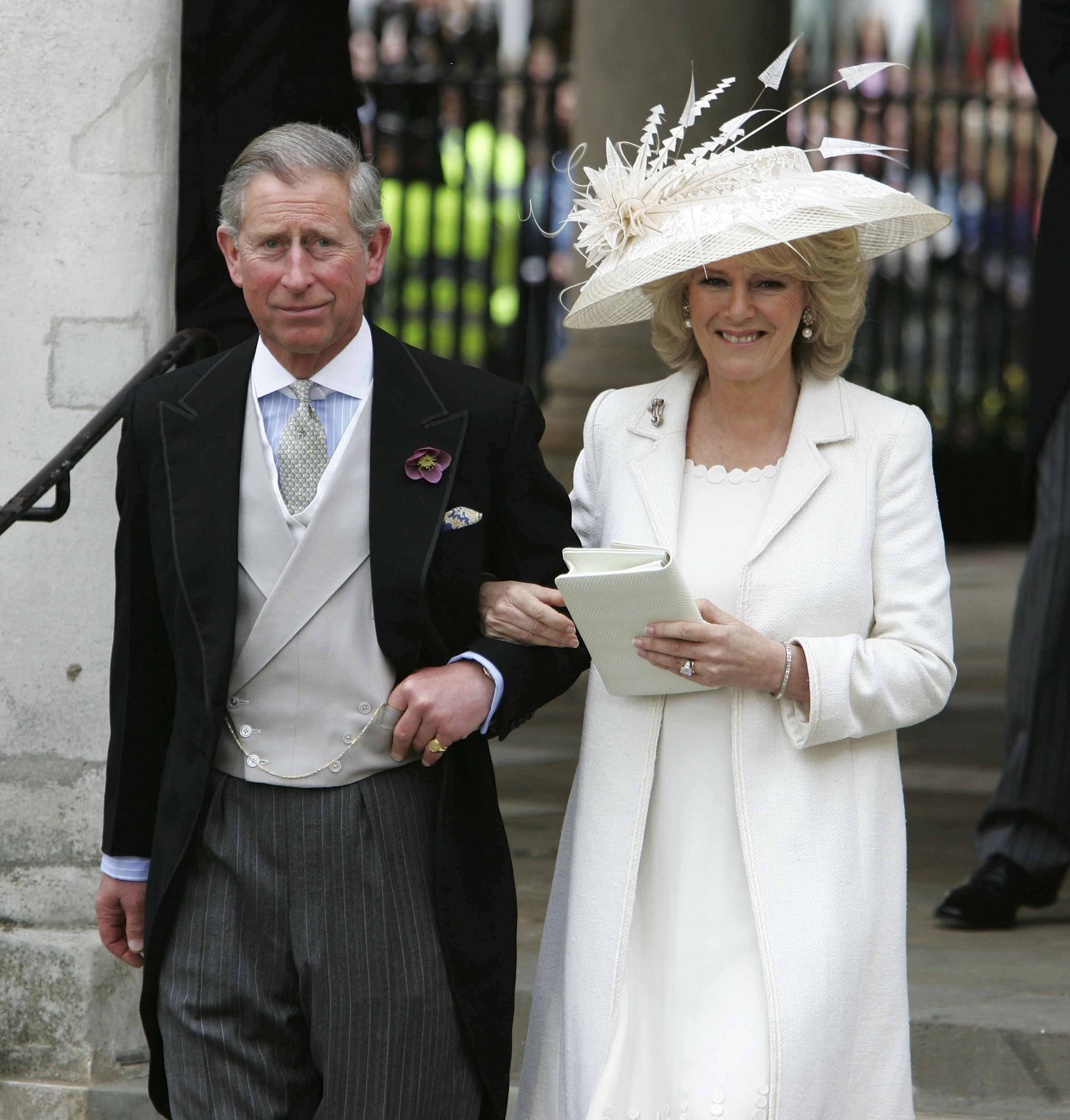 Prince Charles, the Prince of Wales, and his wife Camilla, the Duchess of Cornwall, depart the Civil Ceremony where they were legally married, at The Guildhall, Windsor on April 9, 2005 in Berkshire, England. (Photo by Georges De Keerle/Getty Images)