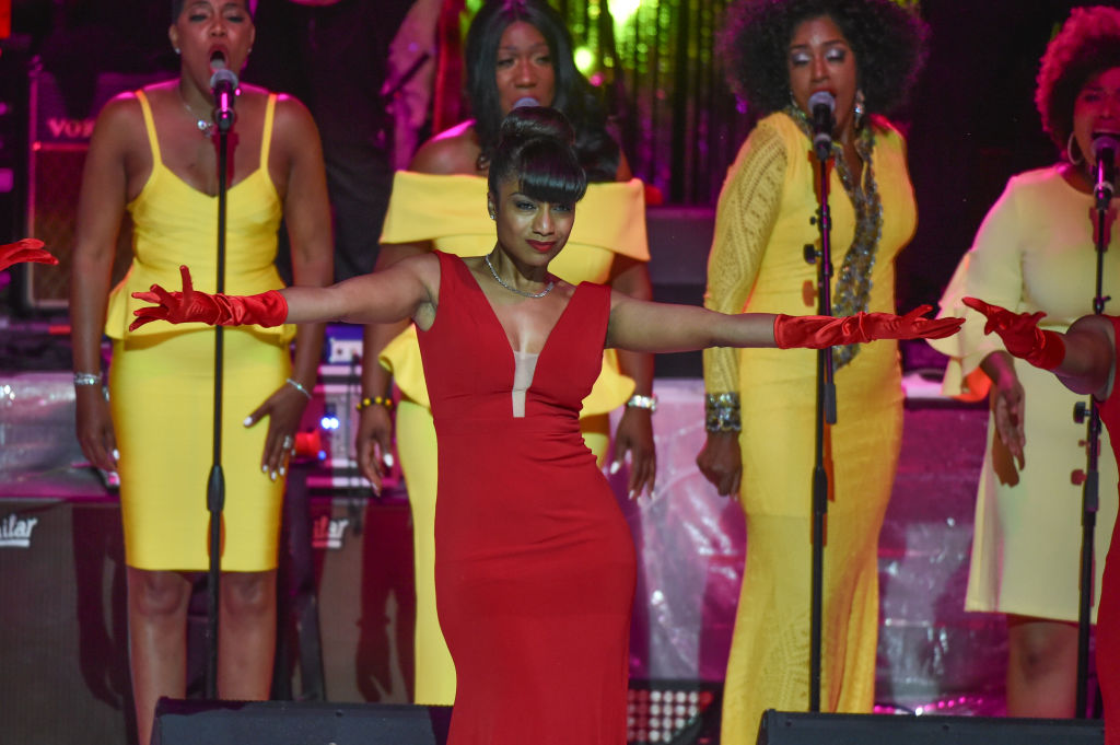 Singer Kiko and dancers perform on stage at a Tribute Concert to celebrate the life of songstress Aretha Franklin at Chene Park on August 30, 2018 in Detroit, Michigan. (Photo by Aaron J. Thornton/Getty Images)
