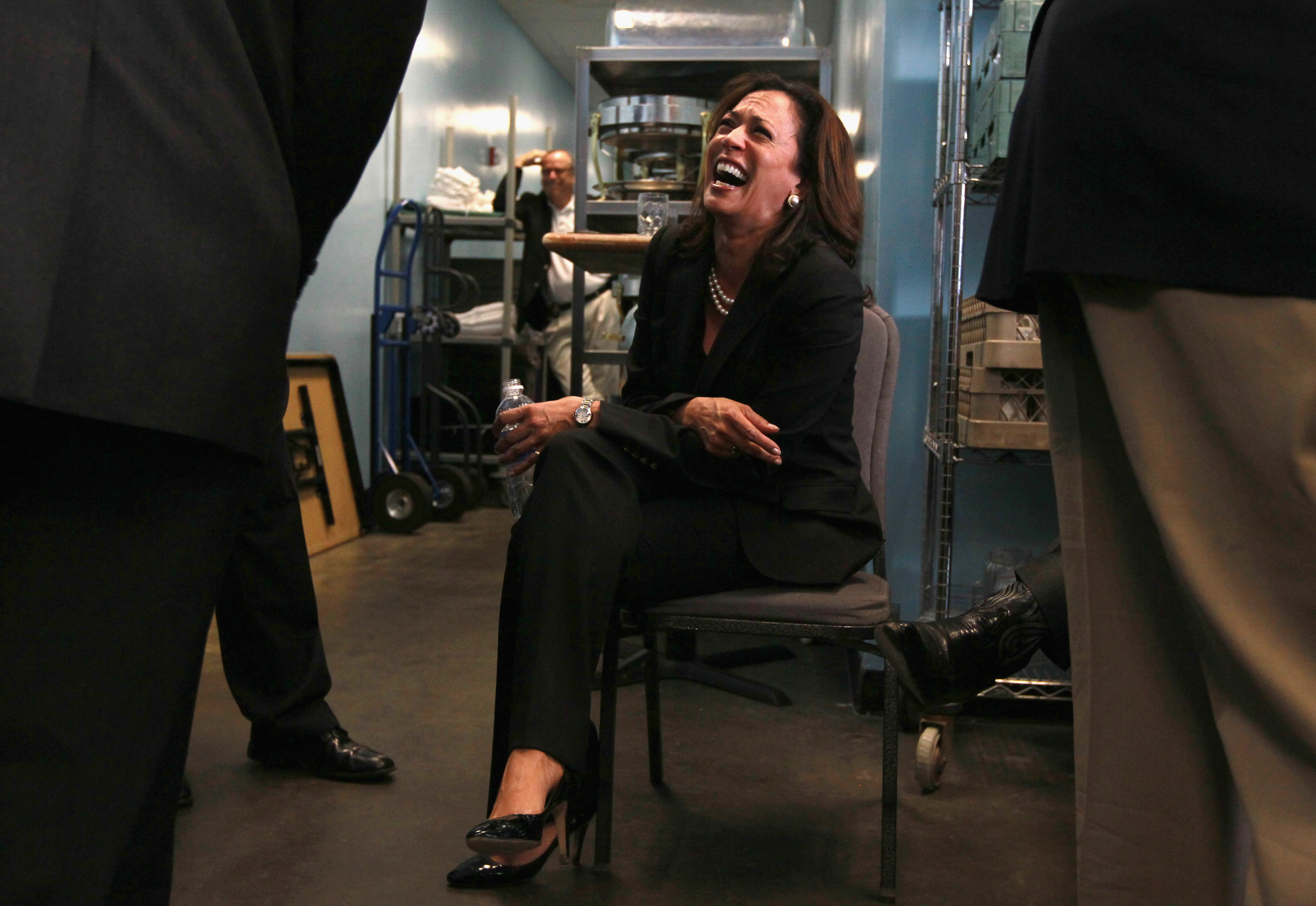 San Francisco district attorney and democratic candidate for California attorney general Kamala Harris laughs as she sits backstage before a get-out-the-vote rally at the National Steinbeck Center on November 1, 2010 in Salinas, California. (Getty Images)