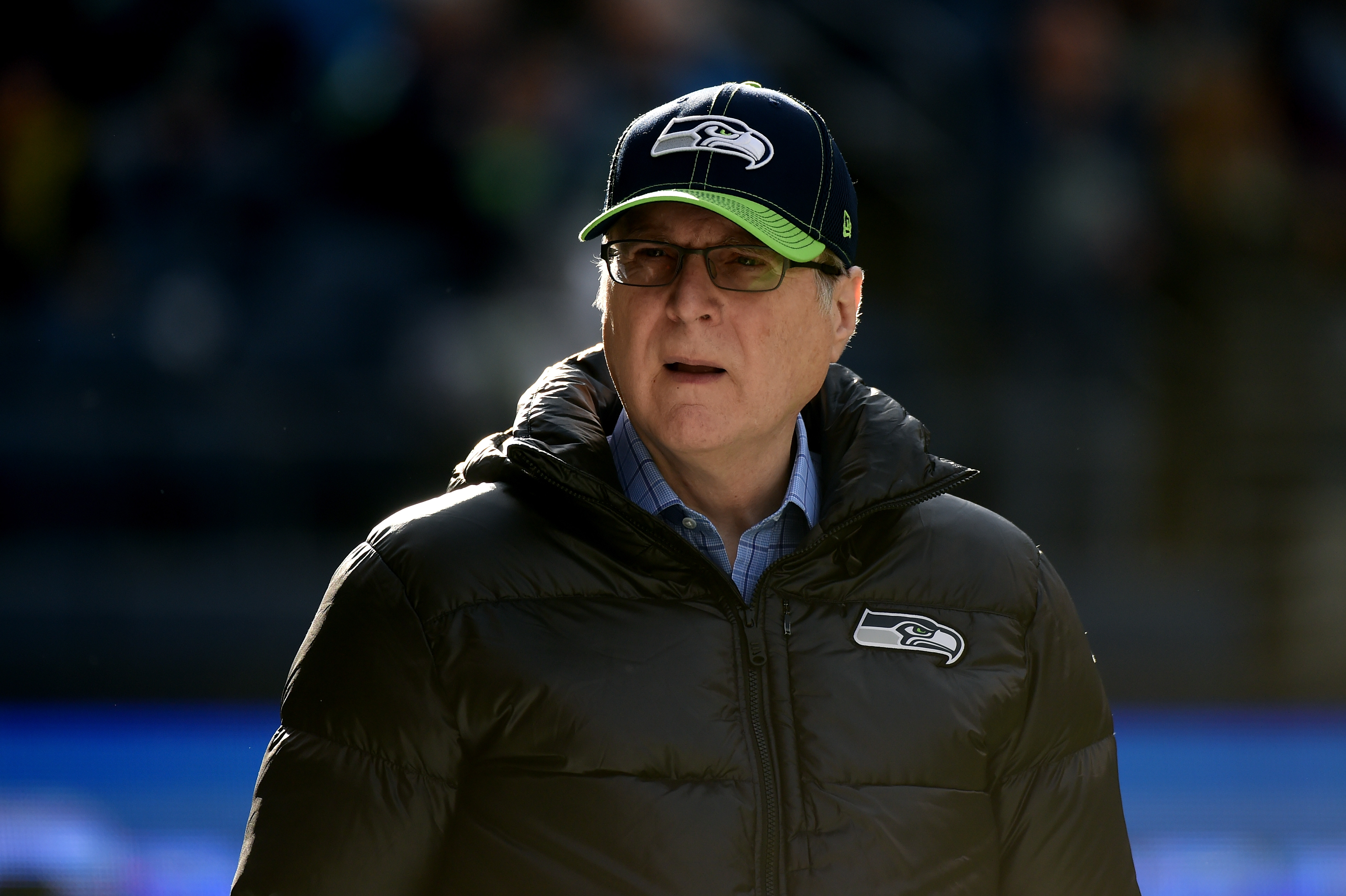 Seattle Seahawks owner Paul Allen walks on the field prior to their game against the Arizona Cardinals at CenturyLink Field on November 23, 2014, in Seattle, Washington (Source: Getty Images)