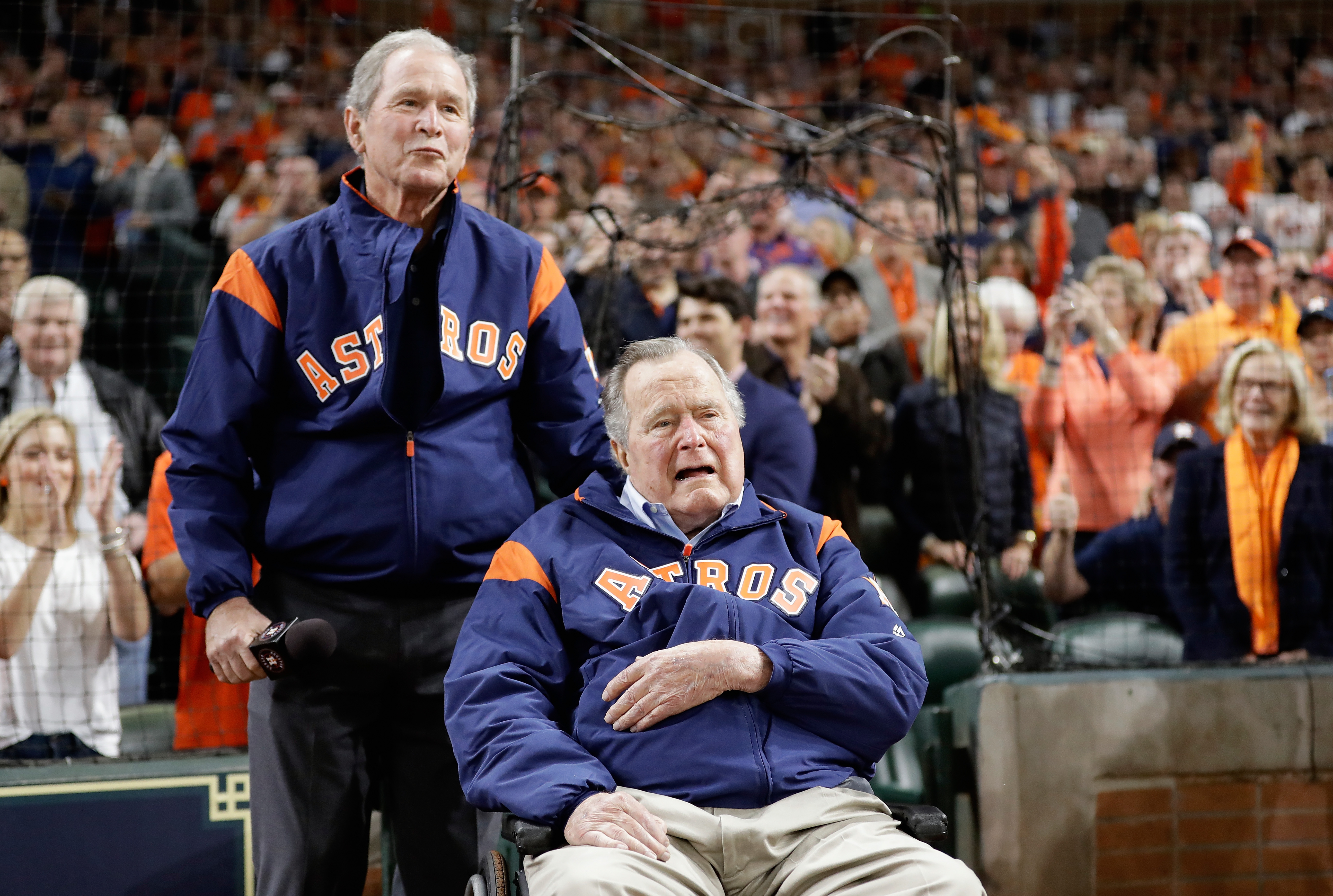 Former United States Presidents George W. Bush and George H.W. Bush speak to the crowd before game five of the 2017 World Series between the Houston Astros and the Los Angeles Dodgers at Minute Maid Park on October 29, 2017 in Houston, Texas.