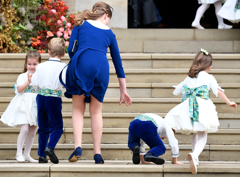 Bridesmaid Princess Charlotte of Cambridge (L) arrives with bridesmaids and pageboys for the royal wedding of Princess Eugenie of York and Jack Brooksbank at St. George's Chapel on October 12, 2018, in Windsor, England. (Getty Images)