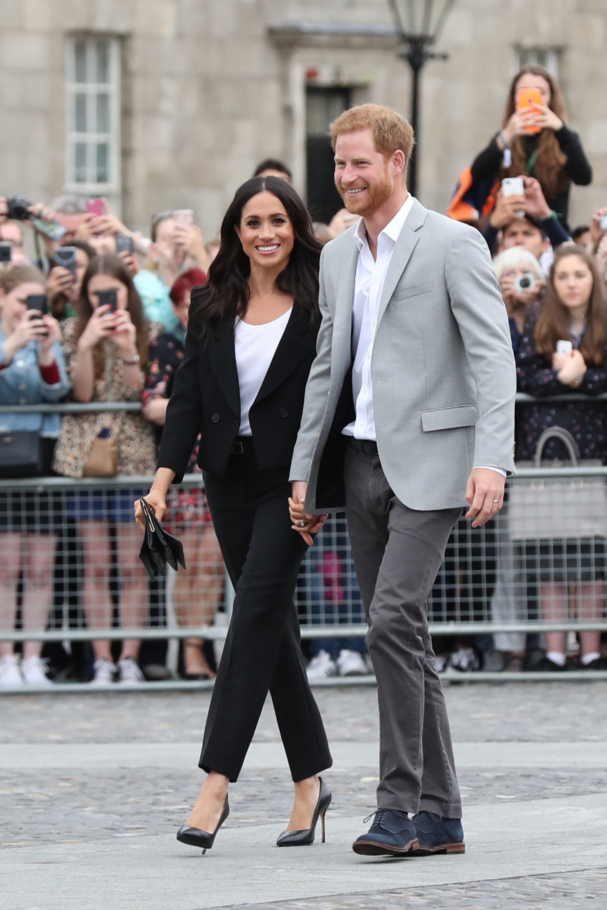 Prince Harry, Duke of Sussex and Meghan, Duchess of Sussex, visit Trinity College on the second day of their official two-day royal visit to Ireland on July 11, 2018, in Dublin, Ireland. It is the royal couple's first foreign trip together since they were married earlier this year.