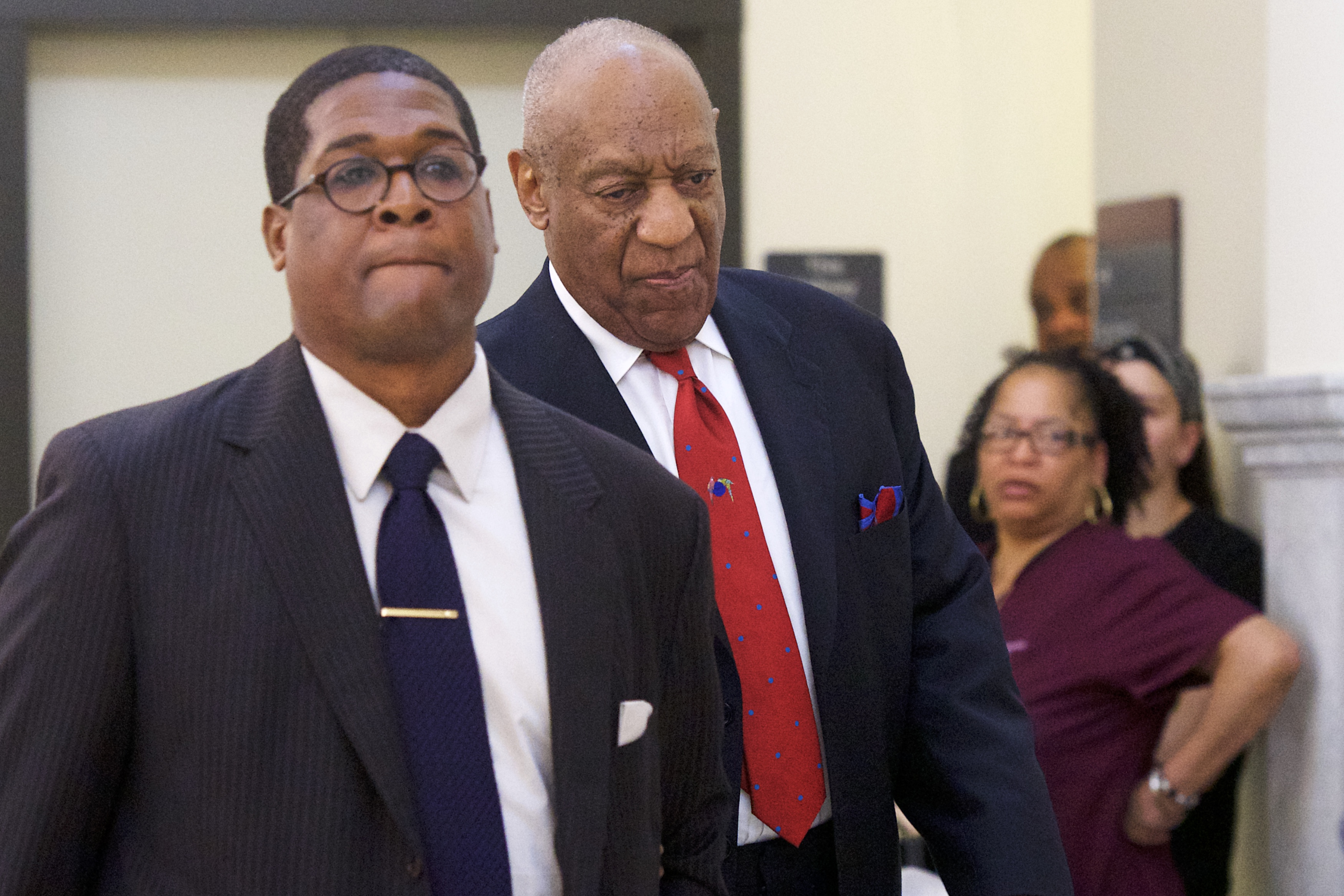Bill Cosby (C) walks through the Montgomery County Courthouse with his publicist, Andrew Wyatt, after being found guilty on all counts in his sexual assault retrial on April 26, 2018 in Norristown, Pennsylvania. Cosby was found guilty on all accounts after a former Temple University employee alleges that the entertainer drugged and molested her in 2004 at his home in suburban Philadelphia. More than 40 women have accused the 80 year old entertainer of sexual assault.