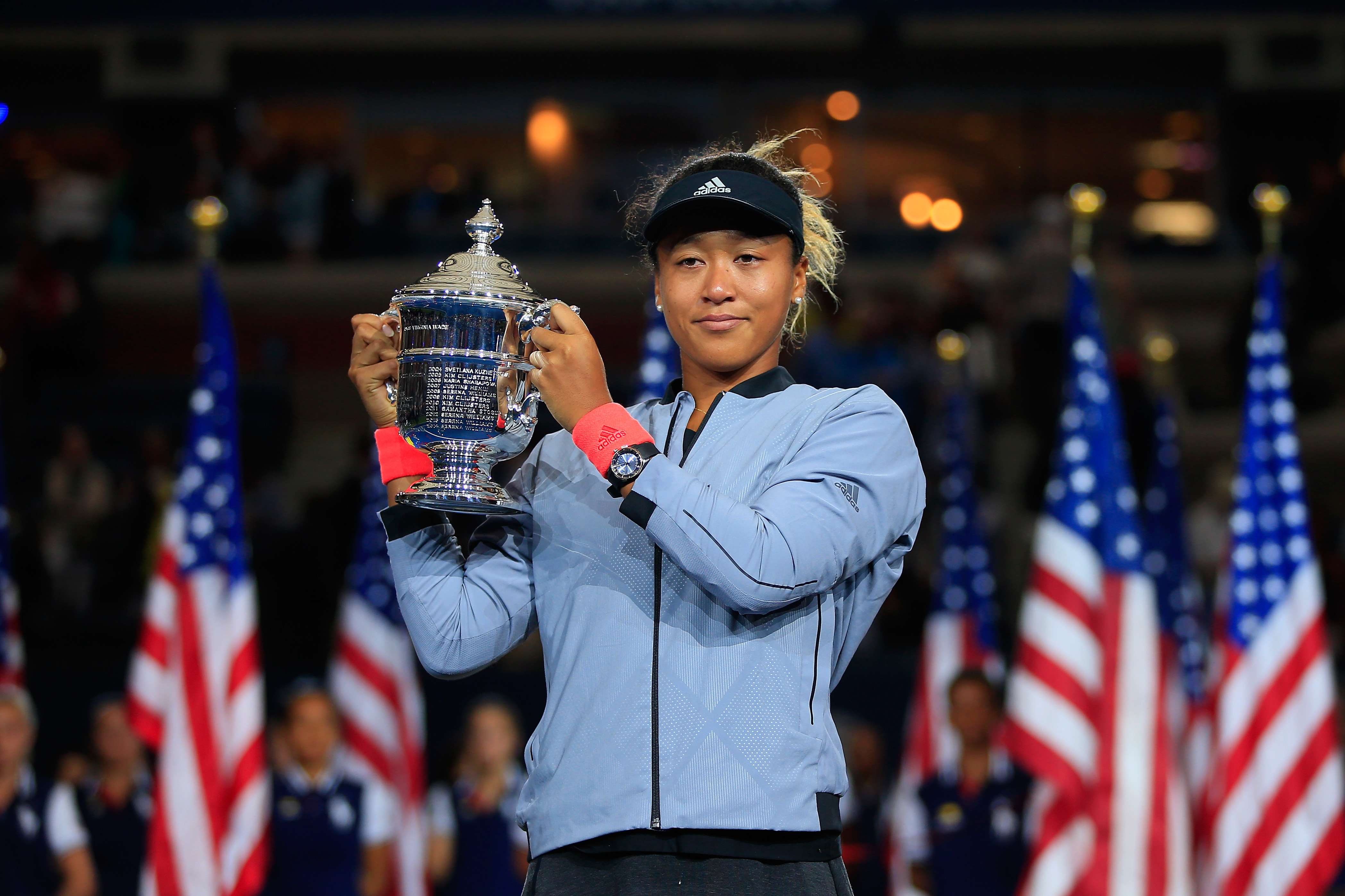 Naomi Osaka of Japan poses with the championship trophy after winning the Women's Singles finals match against Serena Williams of the United States on Day Thirteen of the 2018 US Open at the USTA Billie Jean King National Tennis Center on September 8, 2018, in the Flushing neighborhood of the Queens borough of New York City (Getty Images)