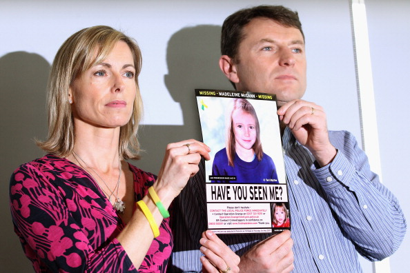 Kate and Gerry McCann hold an age-progressed police image of their daughter during a news conference to mark the 5th anniversary of the disappearance of Madeleine McCann, on May 2, 2012, in London, England (Source: Dan Kitwood/Getty Images)