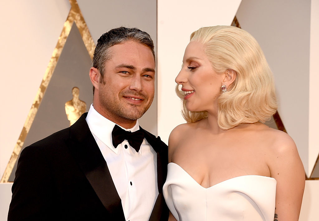 Recording artist Lady Gaga (R) and actor Taylor Kinney attend the 88th Annual Academy Awards at Hollywood & Highland Center on February 28, 2016 in Hollywood, California. (Photo by Jason Merritt/Getty Images)