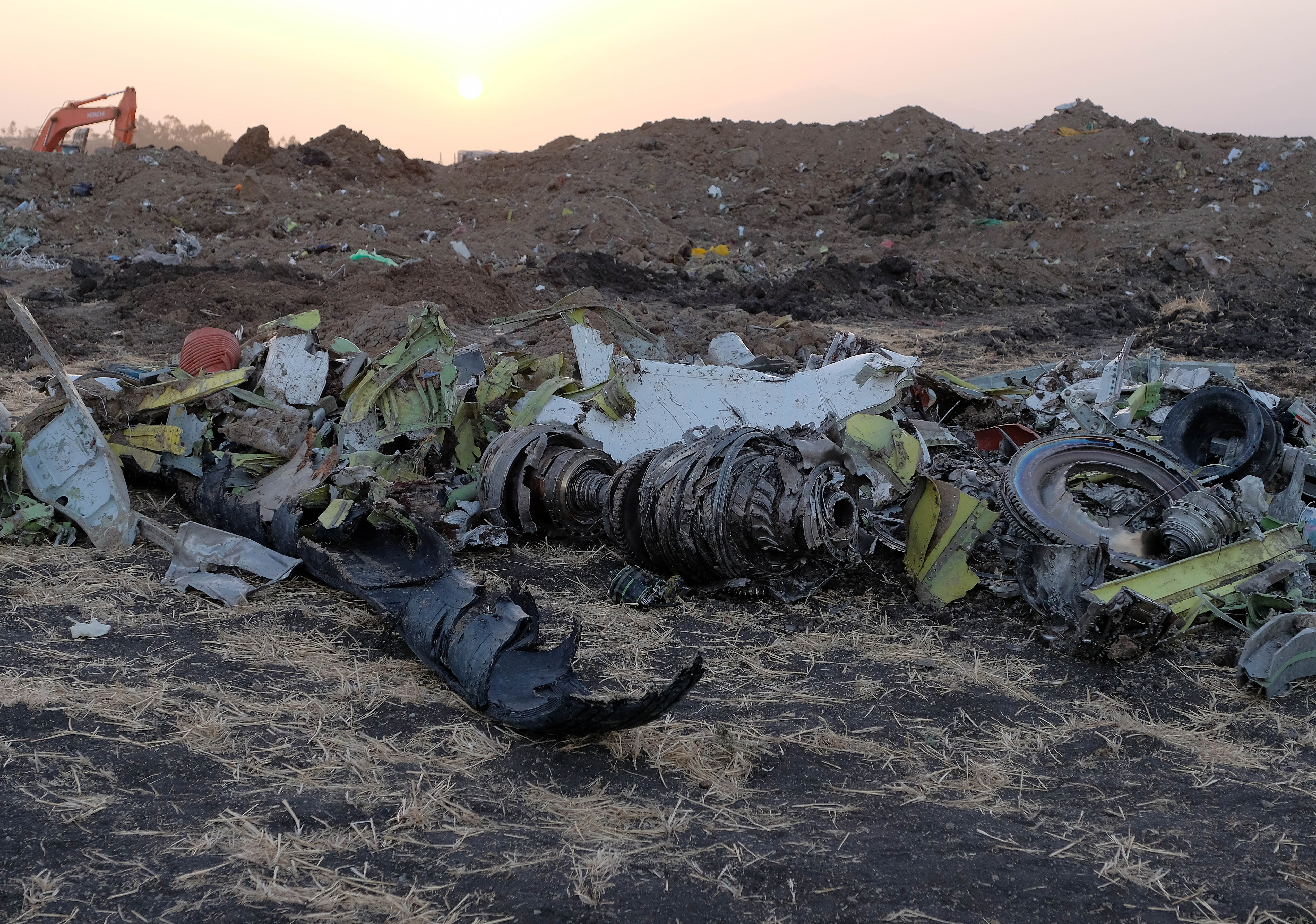 Parts of an engine and the landing gear lie in a pile after being gathered by workers during the continuing recovery efforts at the crash site of Ethiopian Airlines flight ET302 on March 11, 2019, in Bishoftu, Ethiopia. (Getty)