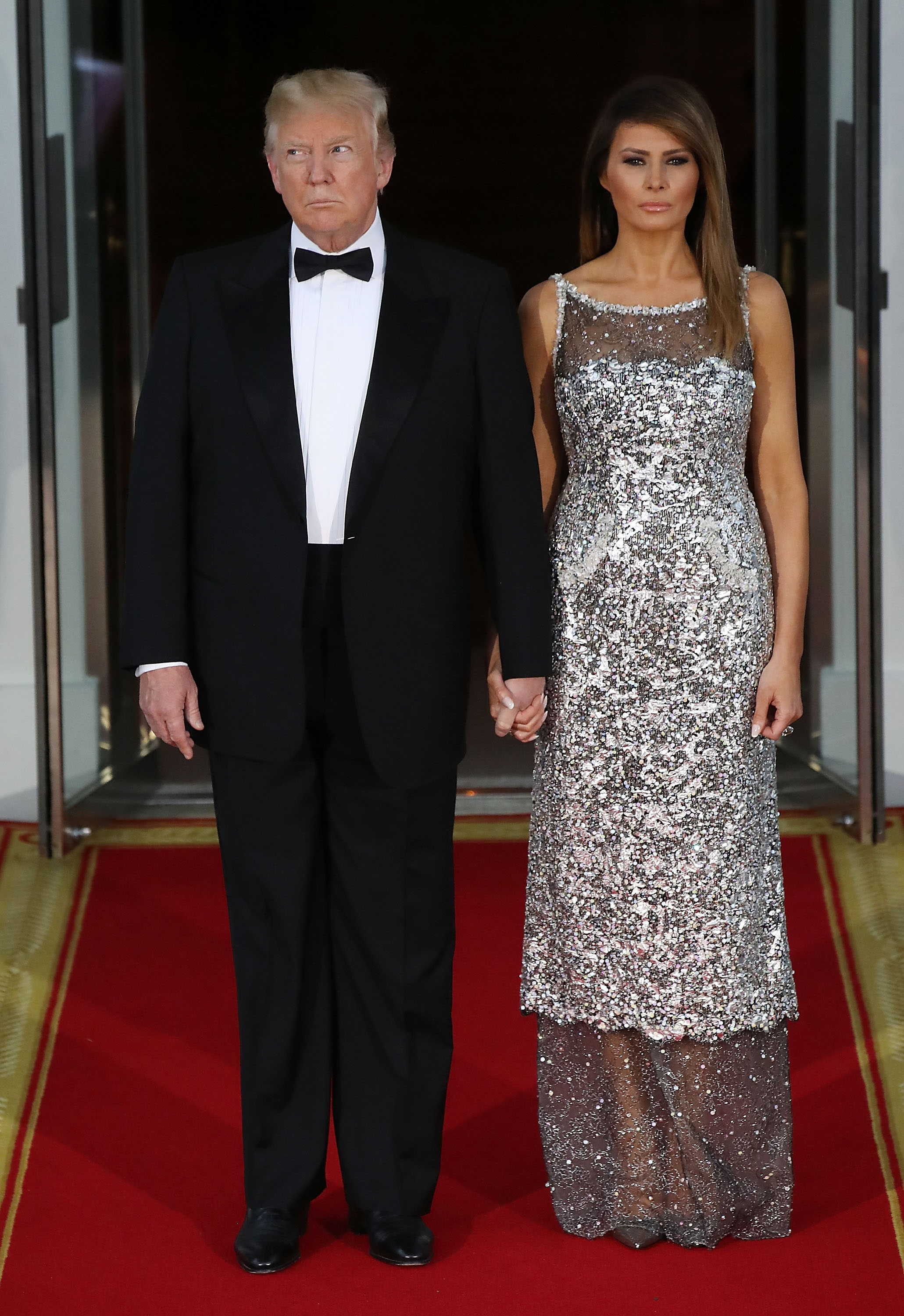 U.S President Donald Trump, and U.S. first lady Melania Trump wait for the arrival of French President Emmanuel Macron, French first lady Brigitte Macron at the North Portico for before a State Dinner at the White House April 24, 2018 in Washington, DC. Trump is hosting Macron for a two-day official visit that included dinner at George Washington's Mount Vernon, a tree planting on the White House South Lawn and a joint news conference.