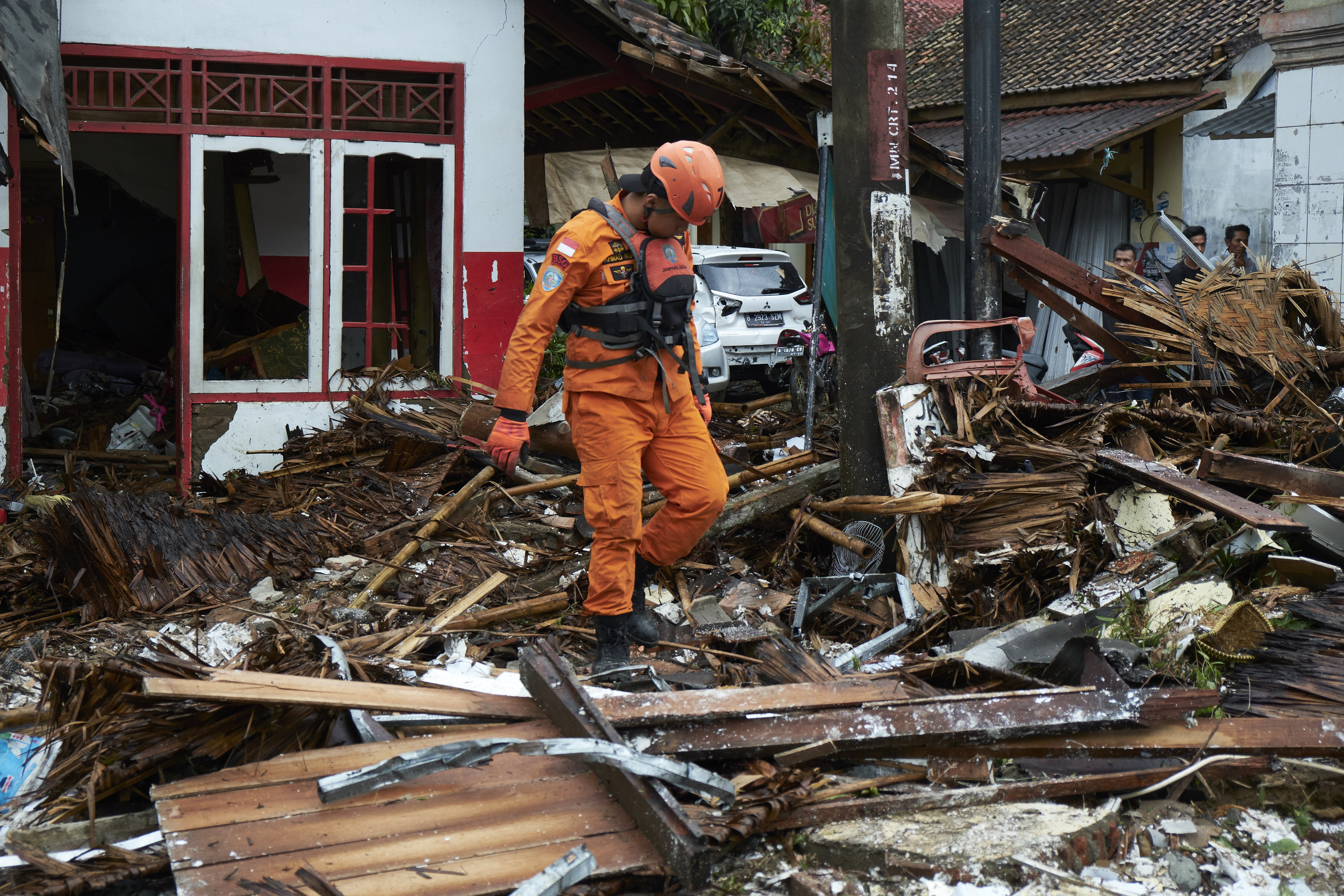 A rescue worker walks through the rubble from houses destroyed by a tsunami on December 23, 2018, in Carita, Indonesia. Over 220 people have reportedly been killed after a volcano-triggered tsunami hit the coast around Indonesia's Sunda Strait on Saturday night, injuring over 600 people. (Getty Images)