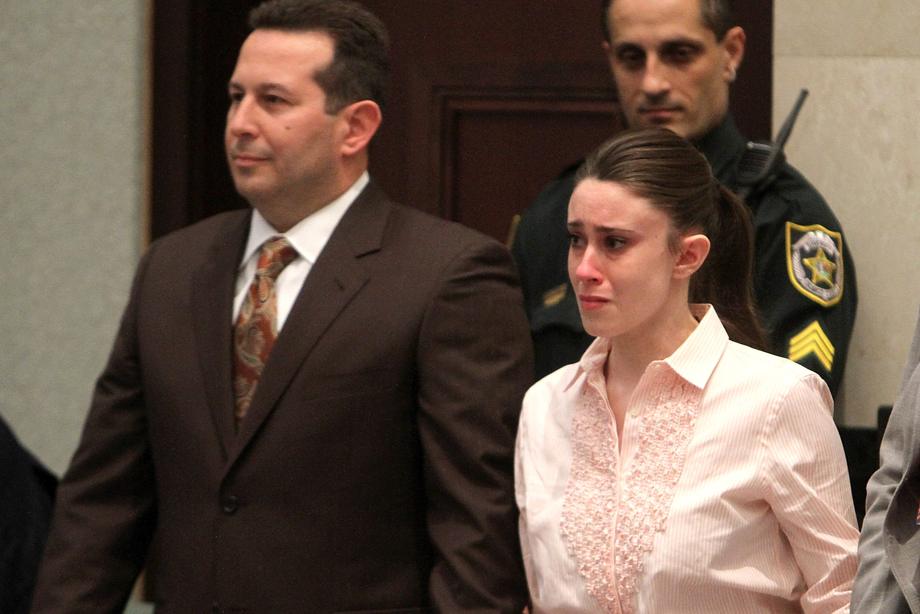 Casey Anthony (R) reacts to being found not guilty on murder charges at the Orange County Courthouse on July 5, 2011, in Orlando, Florida. At left is her attorney Jose Baez. Casey Anthony had been accused of murdering her two-year-old daughter Caylee in 2008. (Getty Images)