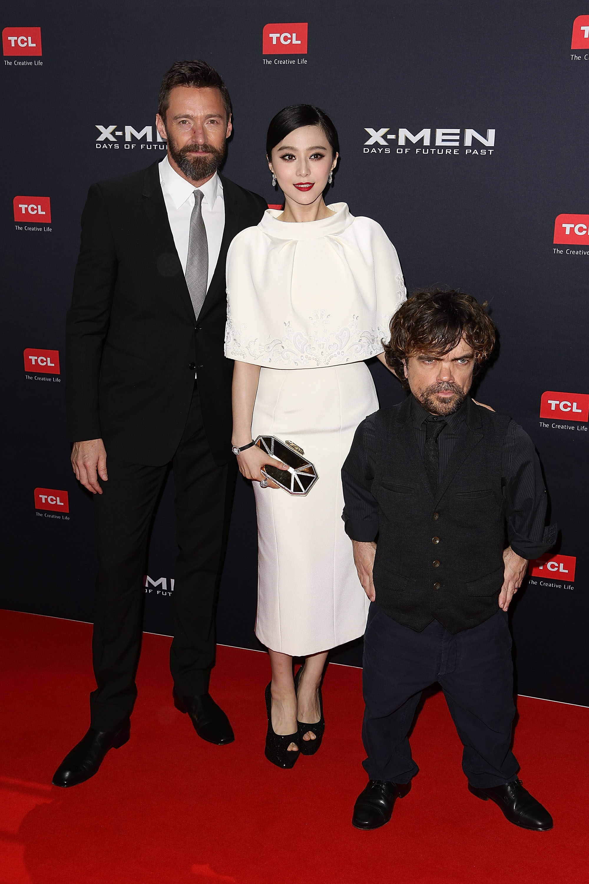 (L-R) Hugh Jackman, Fan Bingbing, and Peter Dinklage pose as they arrive at the Australian premiere of 'X-Men: Days of Future Past' (Source: Graham Denholm/Getty Images)