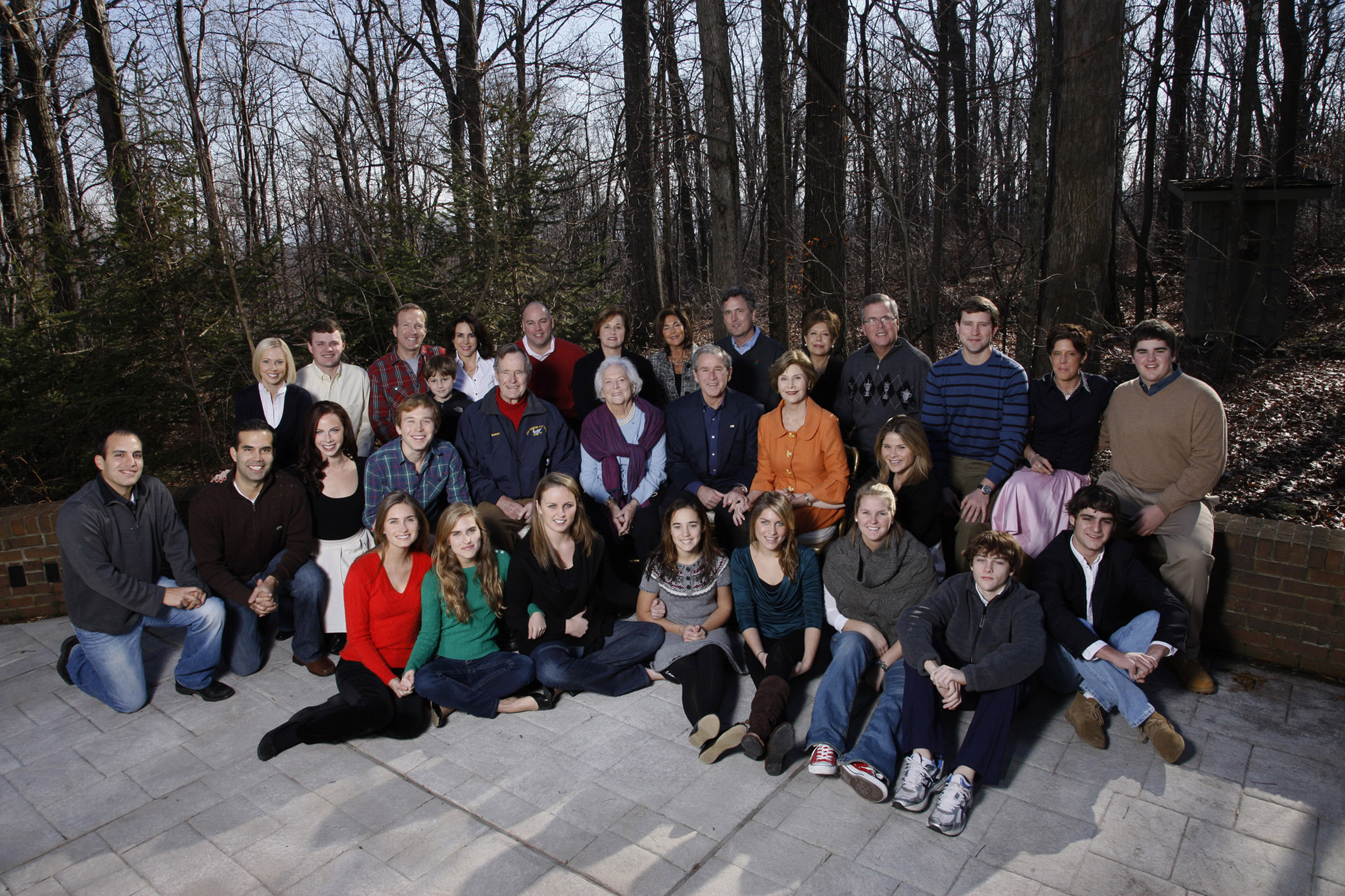 In this handout image provided by the White House, US President George W. Bush and family gather on Christmas December 25, 2008 at Camp David, Maryland. Seated front row, Lauren Bush, Ashley Bush, Ellie LeBlond, Gigi Koch, Elizabeth Andrews, Marshall Bush, Pace Andrews, Walker Bush. Second row, John E. Bush, George P. Bush, Barbara Bush, Pierce Bush, former US President George H.W. Bush, former First Lady Barbara Bush, President George W. Bush, First Lady Laura Bush, Jenna Hager.