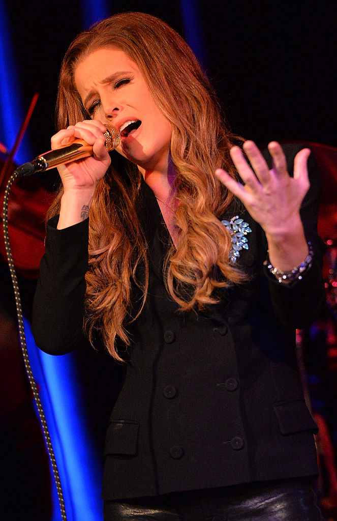Lisa Marie Presley performs at 3rd & Lindsley during the 14th Annual Americana Music Festival & Conference - Festival - Day 3 on September 20, 2013, in Nashville, United States (Source: Rick Diamond/Getty Images for Americana Music Festival)