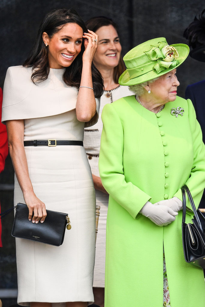 Queen Elizabeth II stands with Meghan accompanied by Samantha Cohen (Back, C) at a ceremony to open the new Mersey Gateway Bridge on June 14, 2018 in the town of Widnes in Halton, Cheshire. (Getty Images)