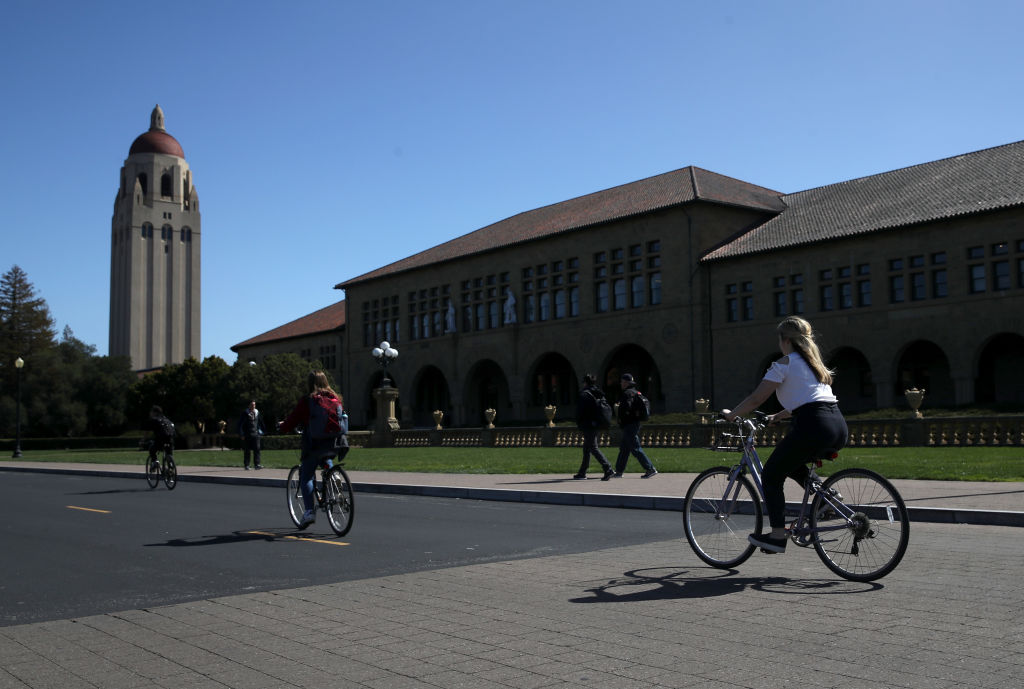 Cyclists ride by Hoover Tower on the Stanford University campus on March 12, 2019, in Stanford, California (Source: Justin Sullivan/Getty Images)