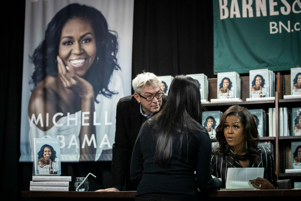 Former U.S. First Lady Michelle Obama greets people as she signs copies of her new book 'Becoming' during a book signing event at a Barnes & Noble bookstore, November 30, 2018, in New York City. (Photo by Drew Angerer/Getty Images)