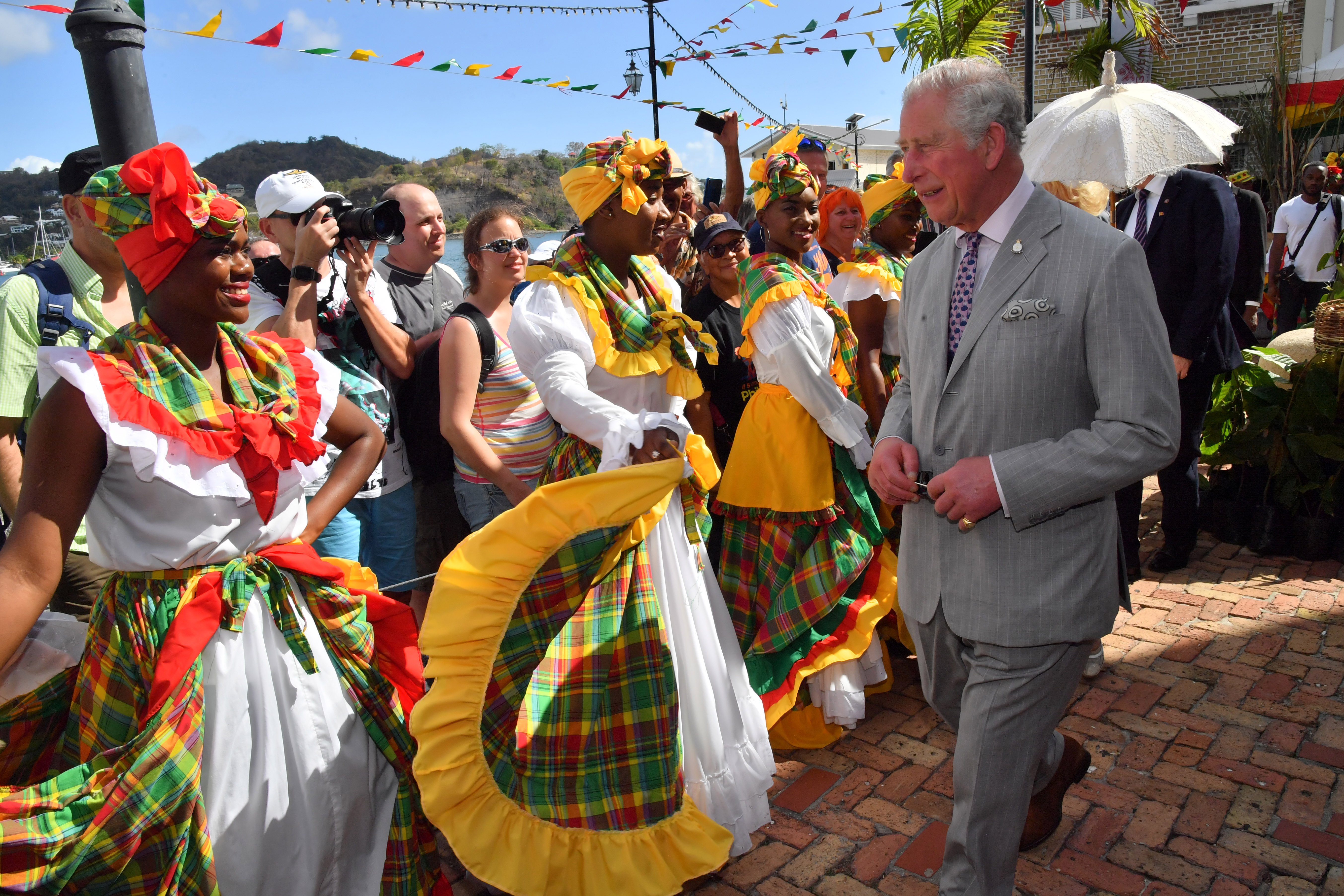 Prince Charles, Prince of Wales and Camilla, Duchess of Cornwall visit a market during their visit to Grenada on March 23, 2019 in Saint George's, Grenada. (Photo by Arthur Edwards - WPA Pool/Getty Images)