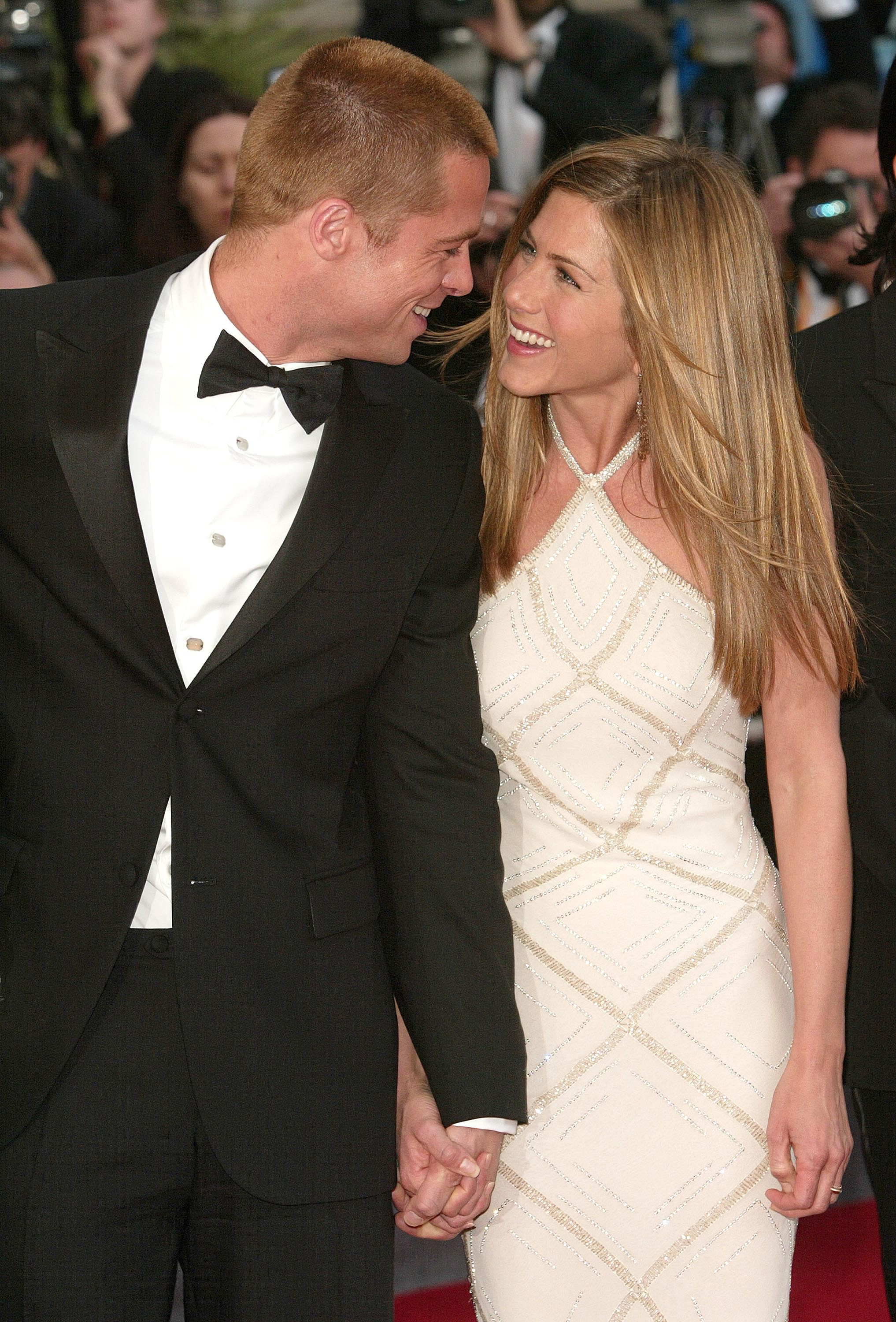 Actor Brad Pitt and wife actress Jennifer Aniston attend the World Premiere of the epic movie 'Troy' at Le Palais de Festival in Cannes, France. Aniston wears a dress by Versace. (Getty Image)