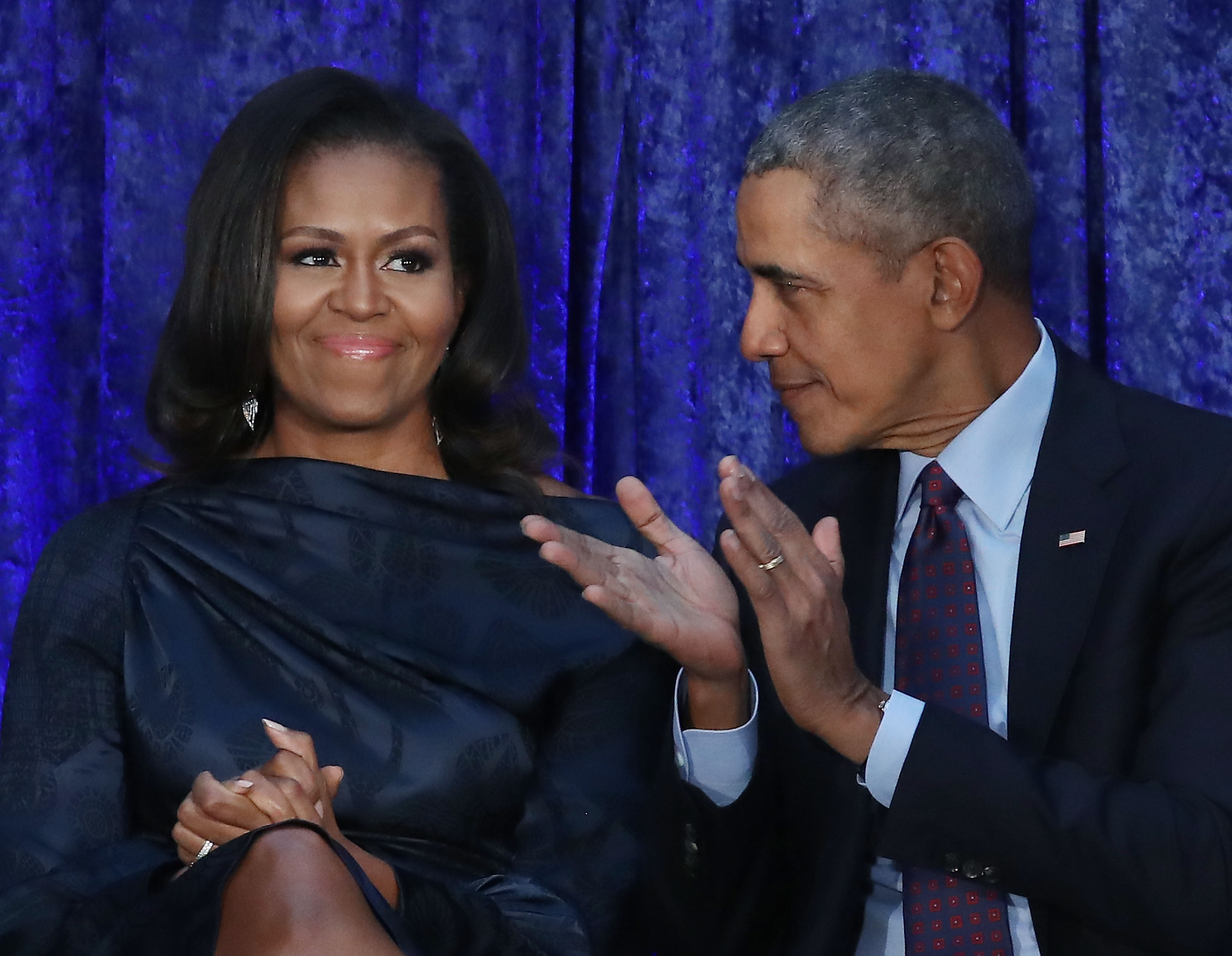 Former U.S. President Barack Obama and First Lady Michelle Obama participate in the unveiling of their official portraits during a ceremony at the Smithsonian's National Portrait Gallery, on February 12, 2018 in Washington, DC (Getty Images)