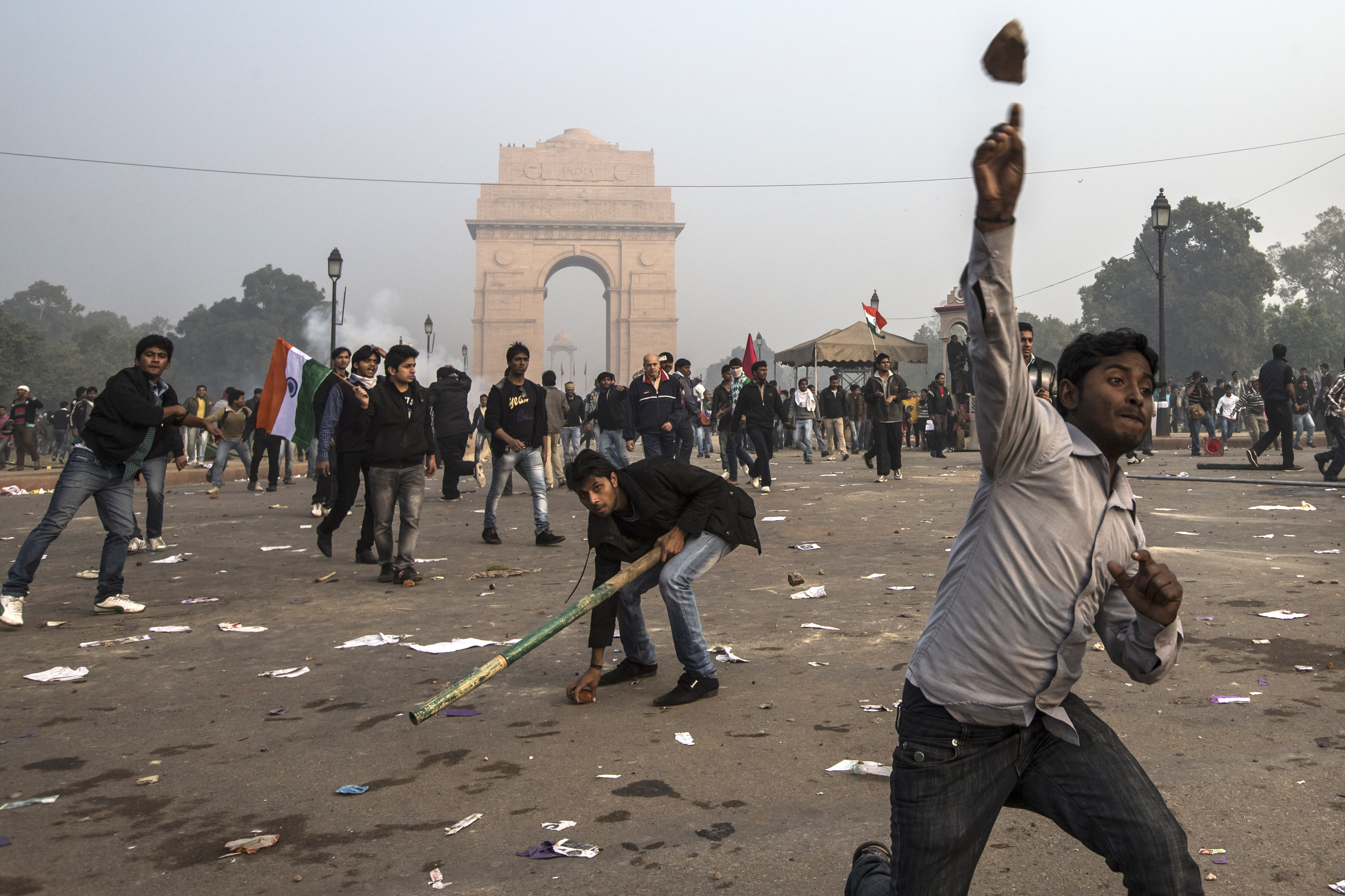 Protestors throw projectiles at Delhi police officers during a protest against the Indian governments reaction to recent rape incidents in India, in front of India Gate on December 23, 2012 in New Delhi, India. (Getty Images)