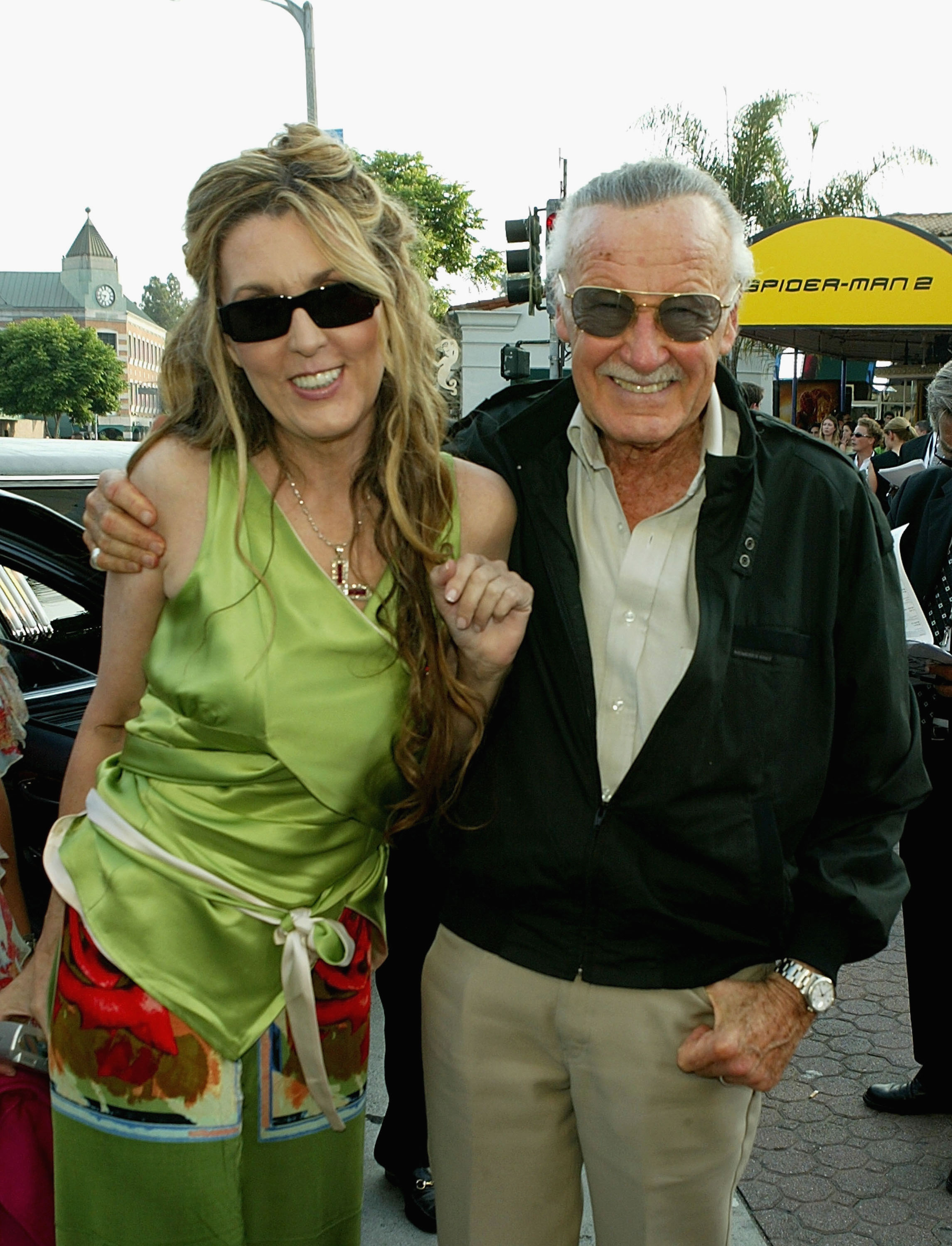 Stan Lee and daughter attend the premiere of the Sony film 'Spider-Man 2' on June 22, 2004 at the Mann Village Theater, in Westwood, California.