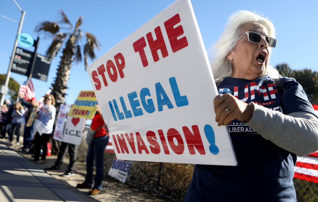 Conservative activists attend a rally for improved border security near the San Ysidro port of entry at the U.S.-Mexico border on December 15, 2018, in San Diego, California. (Photo by Mario Tama/Getty Images)