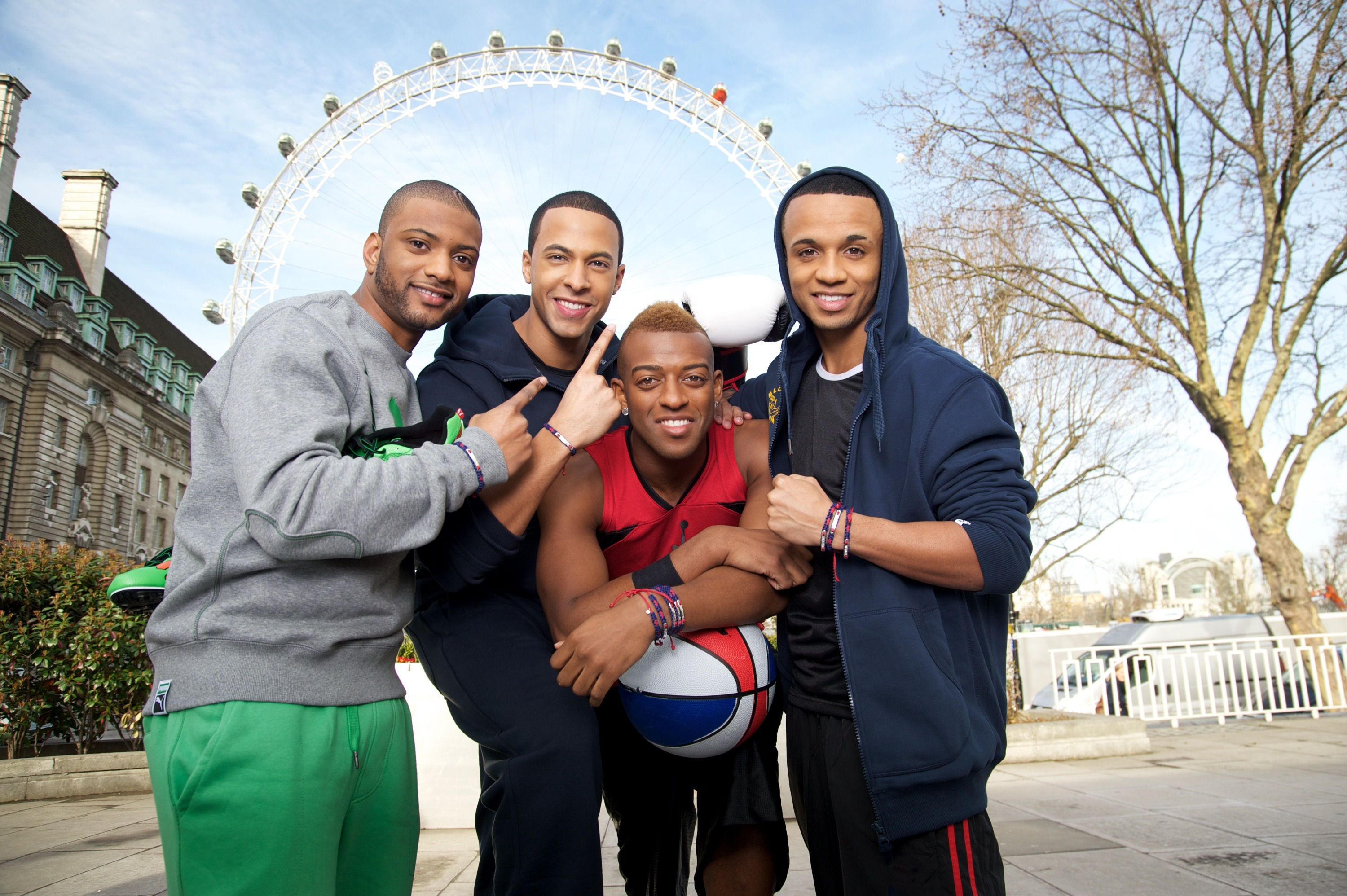 In this handout image provided by Links of London (L-R) Jonathan 'JB' Gill, Marvin Humes, Oritse Williams and Aston Merrygold of the band JLS pose for pictures wearing their Links of London Team GB Bands on March 8, 2012 in London, England. The Links of London Team GB band is on sale from www.linksoflondon.com