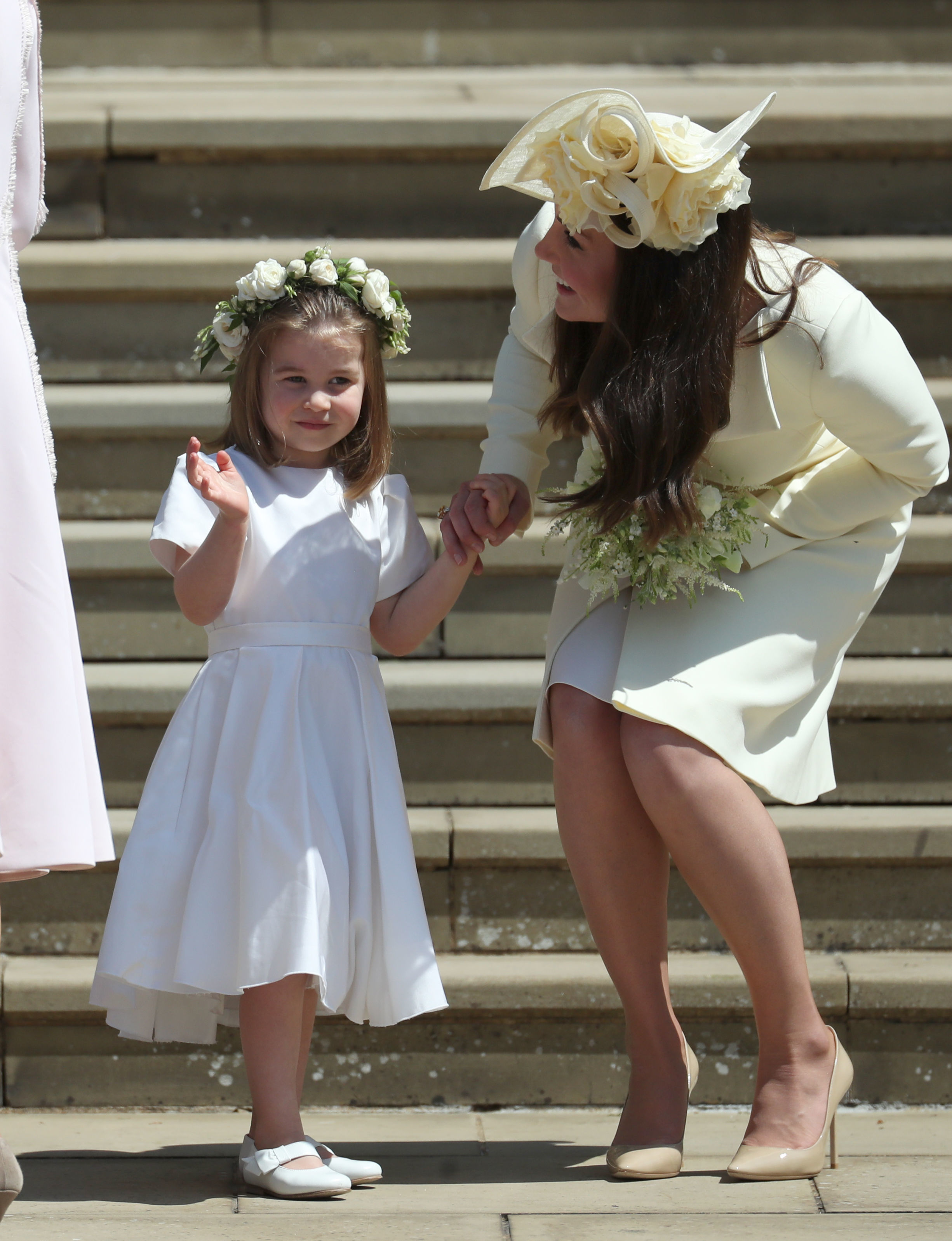 Princess Charlotte and Catherine, Duchess of Cambridge leave St George's Chapel after the wedding of Prince Harry and Meghan Markle in St George's Chapel at Windsor Castle on May 19, 2018 in Windsor, England.