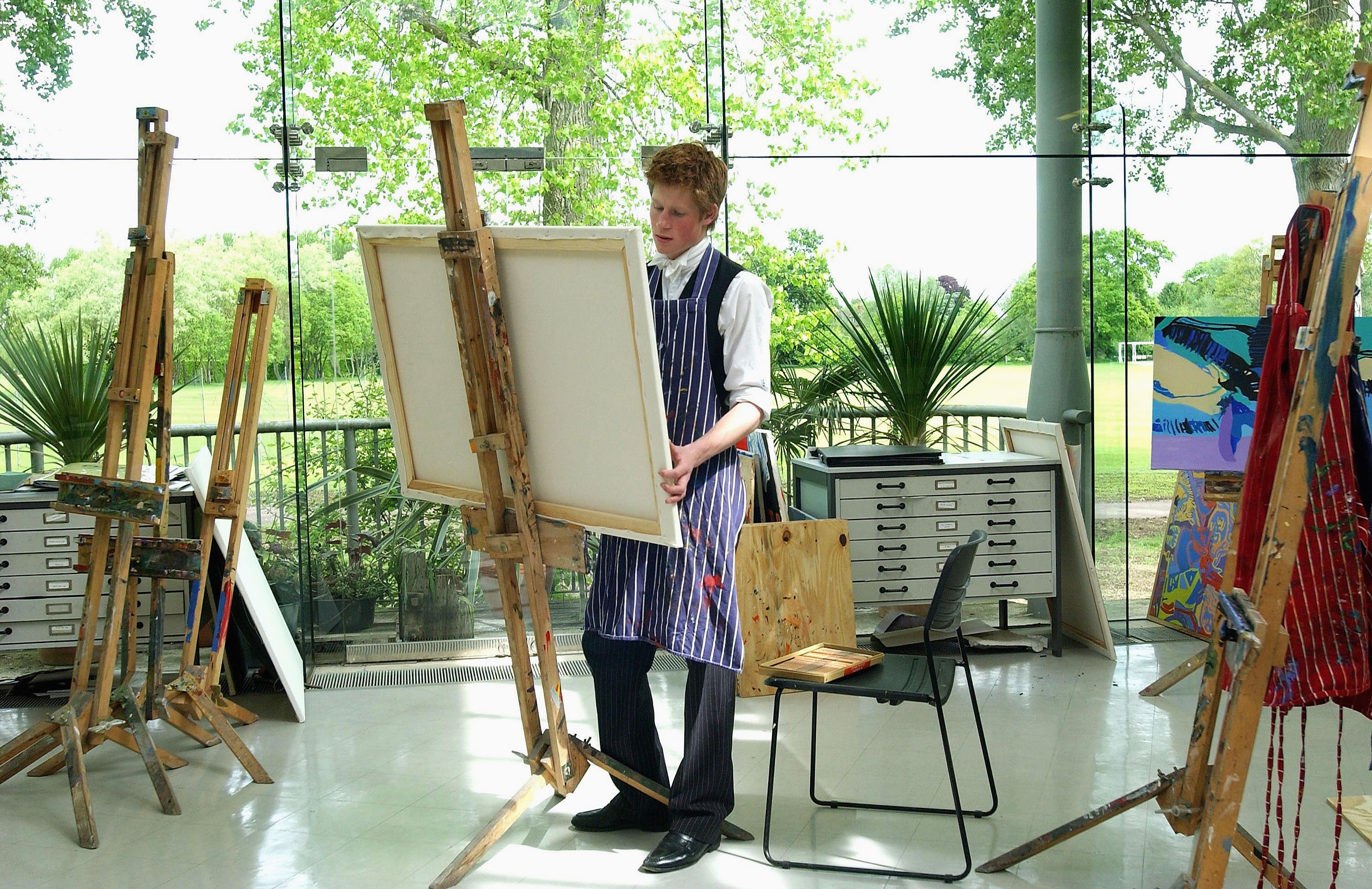 (FILE PHOTO) The youngest son of the Prince of Wales, Prince Harry at work on May 12, 2003 in the Drawing School at Eton College, Eton in England. The Royal Family on October 9, 2004 denied allegations that the Prince had cheated in his art A-level